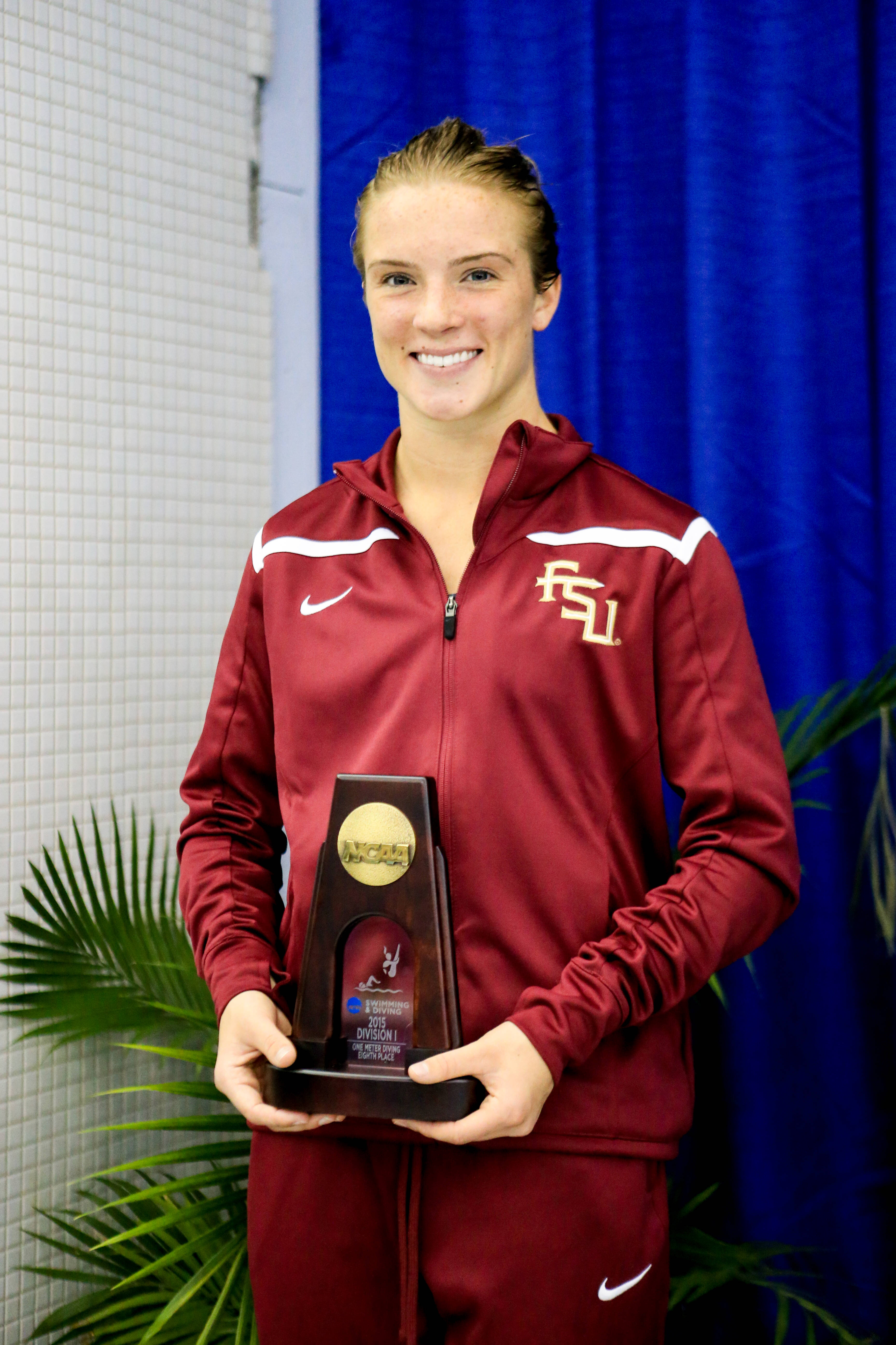 Katrina Young smiles on the podium