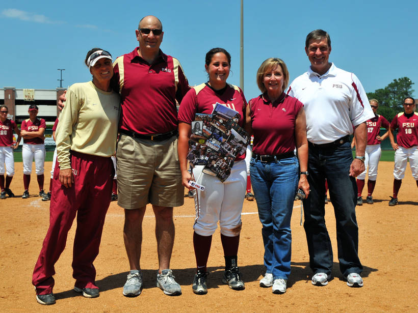 Tory Haddad with her parents, head coach Lonni Alameda and athletics director Randy Spetman.