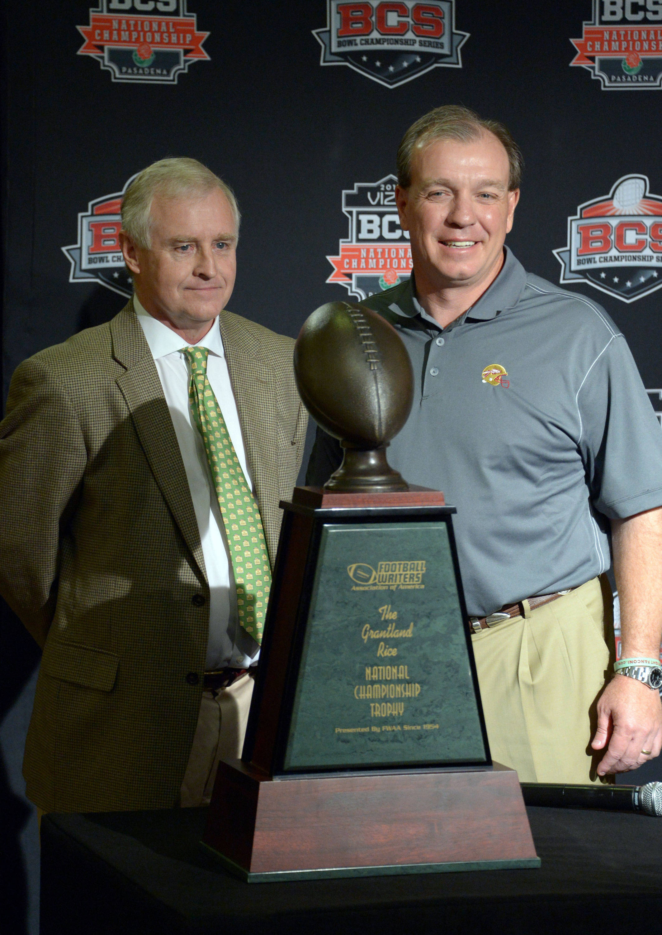 Florida State Seminoles coach Jimbo Fisher (right) is presented the Grantland Rice trophy by Football Writers Association president and Austin-American Statesman columnist Kirk Bohls at 2014 BCS National Championship press conference at Newport Beach Marriott. Mandatory Credit: Kirby Lee-USA TODAY Sports