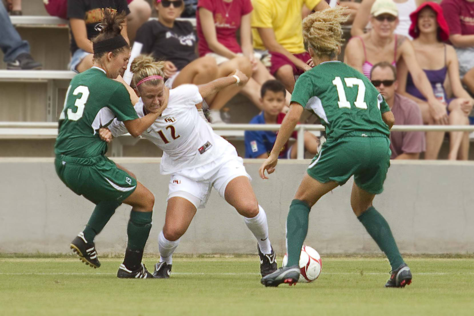 Breezy Hupp (12) is grabbed by the neck and pulled to the ground by a Stetson player.