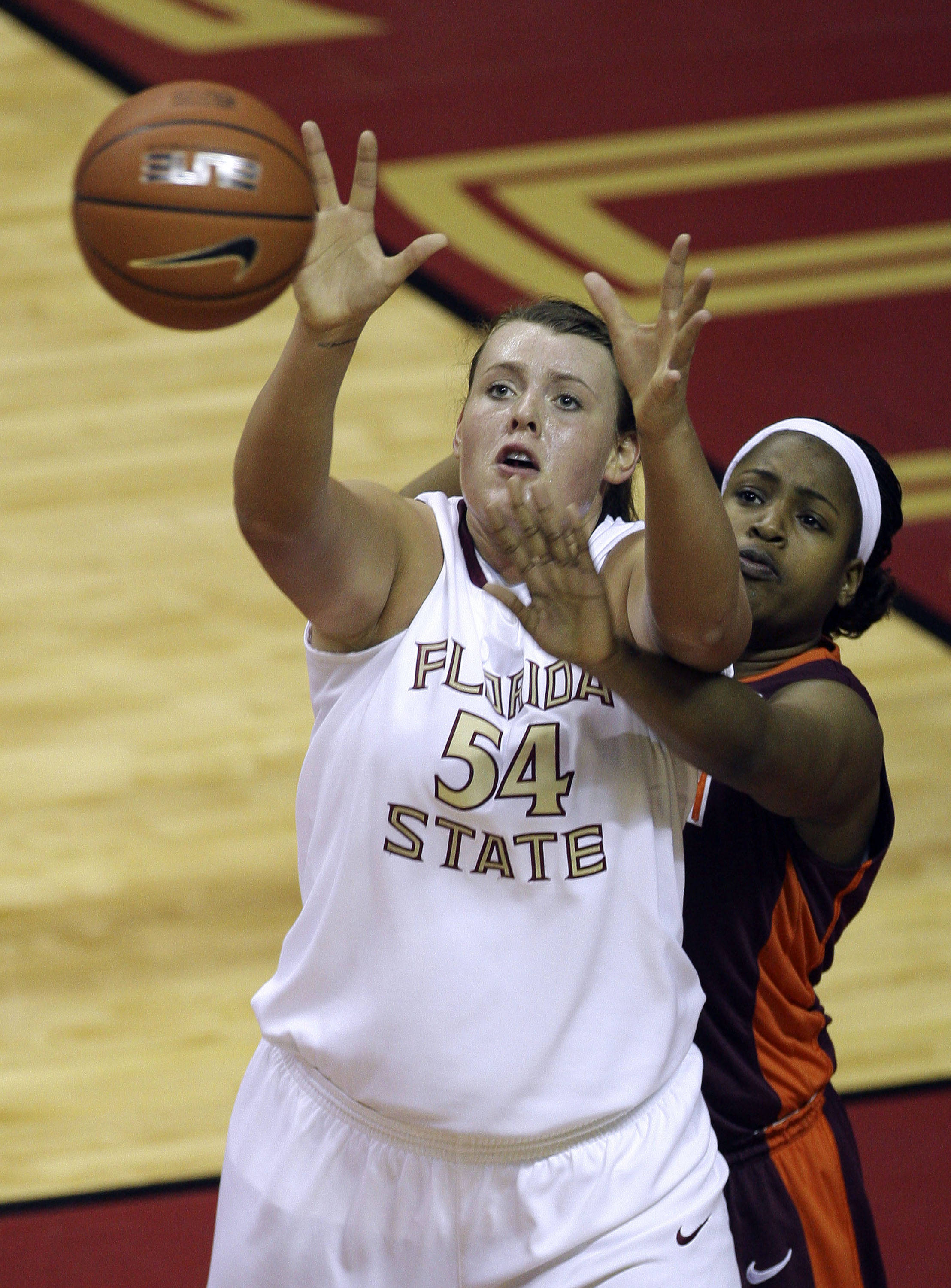 Florida State's Cierra Brevard (54) catches a first-half pass as Virginia Tech's Taylor Ayers attempts to defend during an NCAA college basketball game, Thursday, Feb. 18, 2010, in Tallahassee, Fla. (AP Photo/Phil Coale)