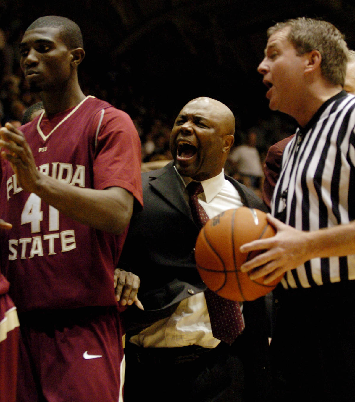 Florida State's head coach Leonard Hamilton yells to his bench to keep quiet as official Curtis Shaw issues a technical on the bench in the second half of a basketball game in Durham, N.C., on Sunday, Feb. 4, 2007. Florida State upset Duke 68-67. (AP Photo/Sara D. Davis)