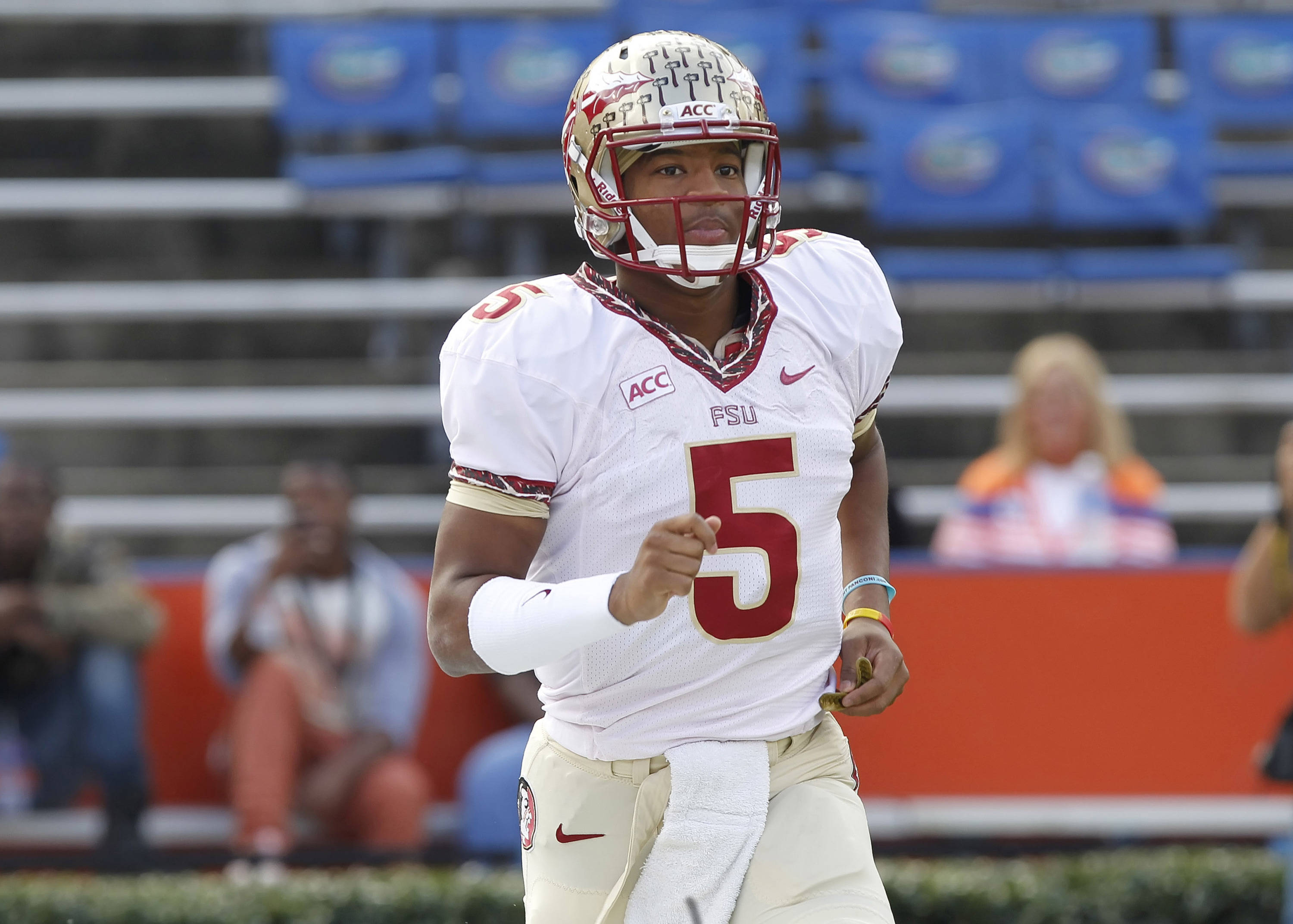 Jameis Winston (5) runs out onto the field. Mandatory Credit: Kim Klement-USA TODAY Sports