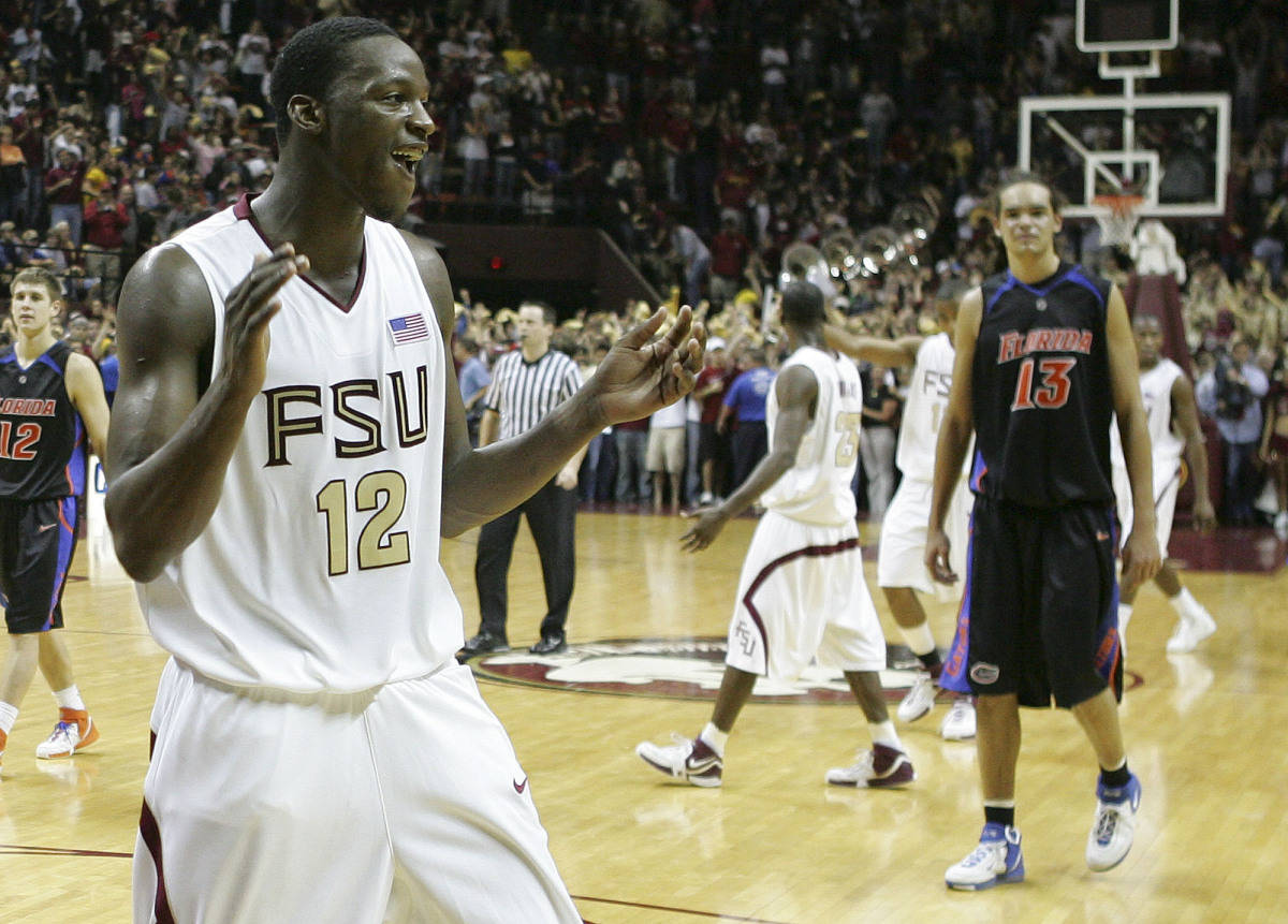 Florida State's Al Thornton, left, celebrates the Seminoles 70-66 upset win over the Florida Gators, Sunday, Dec. 3, 2006, in Tallahassee, Fla. Florida's Joakim Noah, right, walks off the court.(AP Photo/Brandon Goodman)