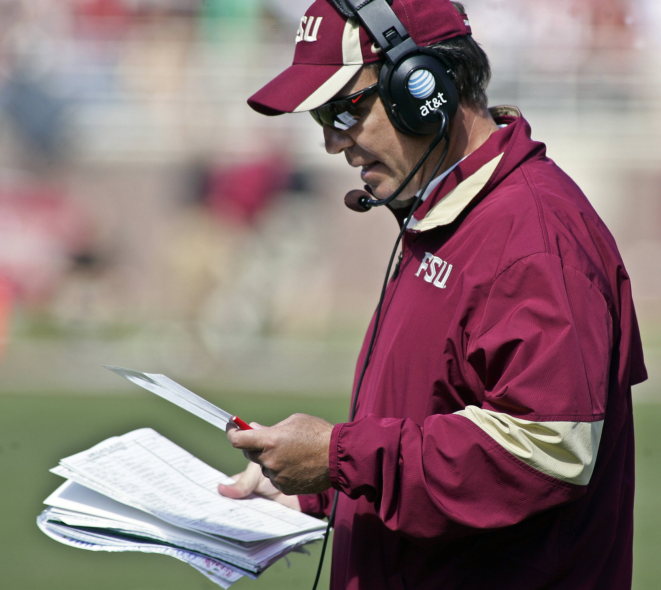 Florida State coach Jimbo Fisher looks for a play to call in the second quarter against North Carolina State. (AP Photo/Phil Sears)