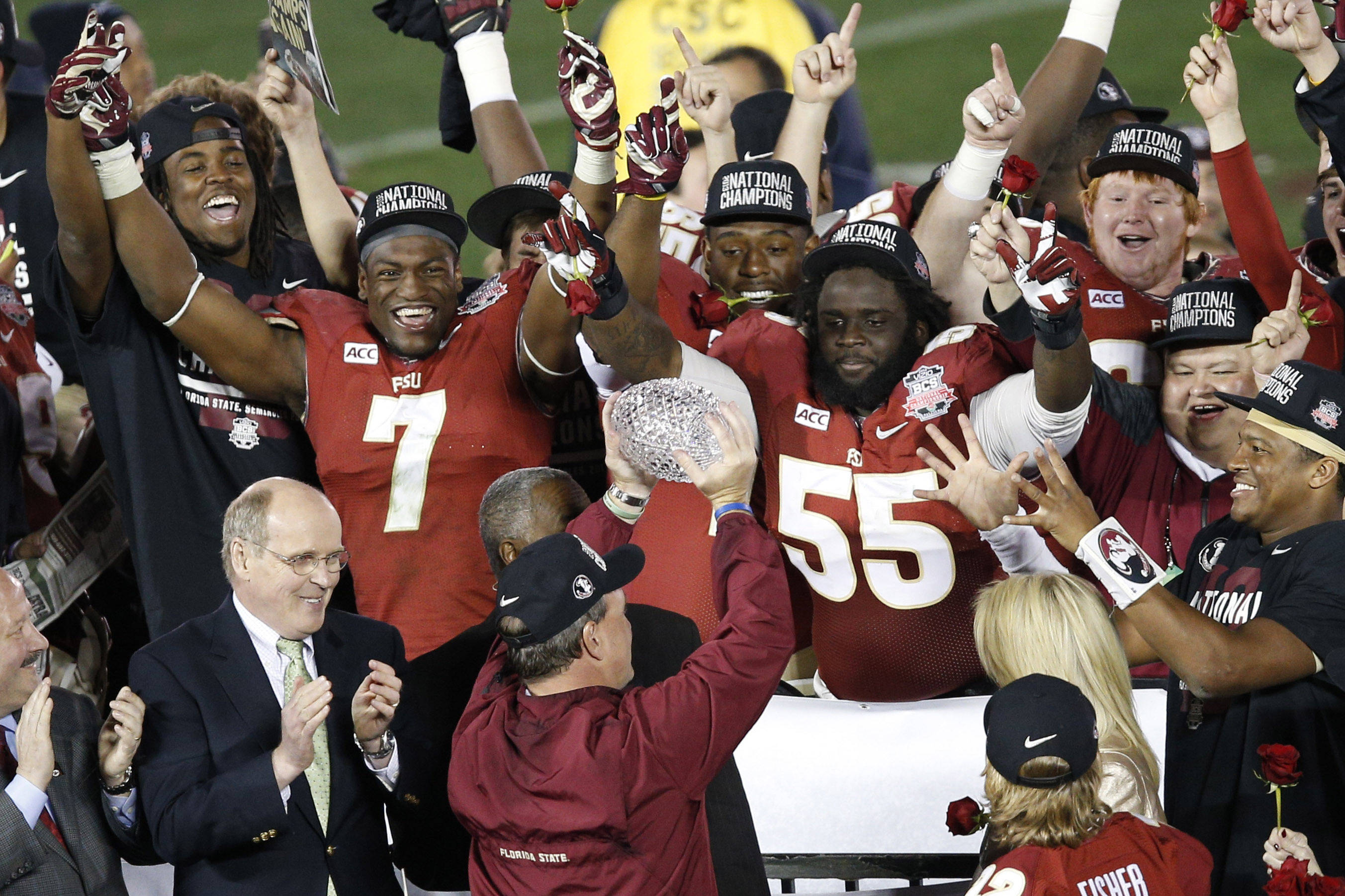 Jan 6, 2014; Pasadena, CA, USA; Florida State Seminoles head coach Jimbo Fisher hoists the Coaches Trophy after defeating the Auburn Tigers 34-31 in the 2014 BCS National Championship game at the Rose Bowl.  Mandatory Credit: Kelvin Kuo-USA TODAY Sports