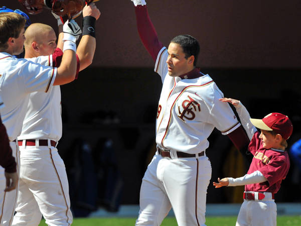 Rafael Lopez celebrates after hitting his first home run of the season.
