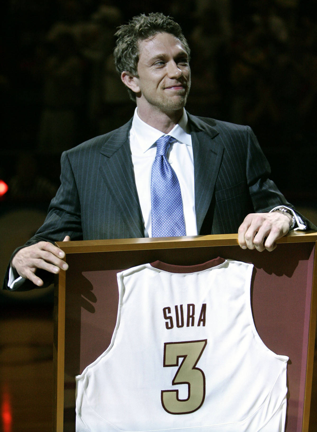 Bob Sura, former Florida State basketball player, smiles as his jersey is retired at halftime of the North Carolina State-Florida State game Saturday, Feb. 24, 2007, in Tallahassee, Fla. Sura played at Florida State from 1991 to 1995, and is a current member of the NBA'S Houston Rockets. (AP Photo/Phil Coale)