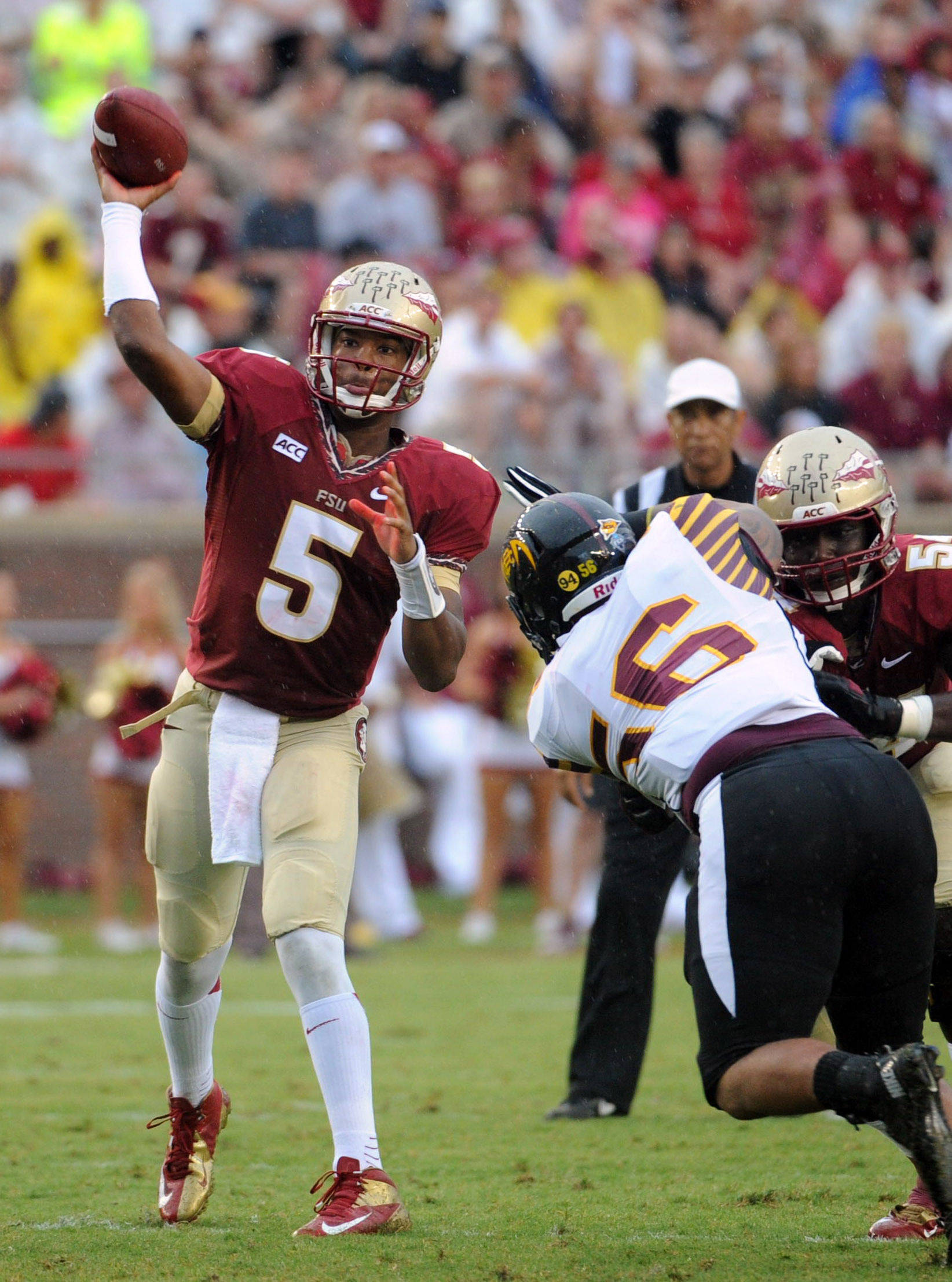 Florida State Seminoles quarterback Jameis Winston (5) throws the ball during the game against the Bethune-Cookman Wildcats. (Melina Vastola-USA TODAY Sports)