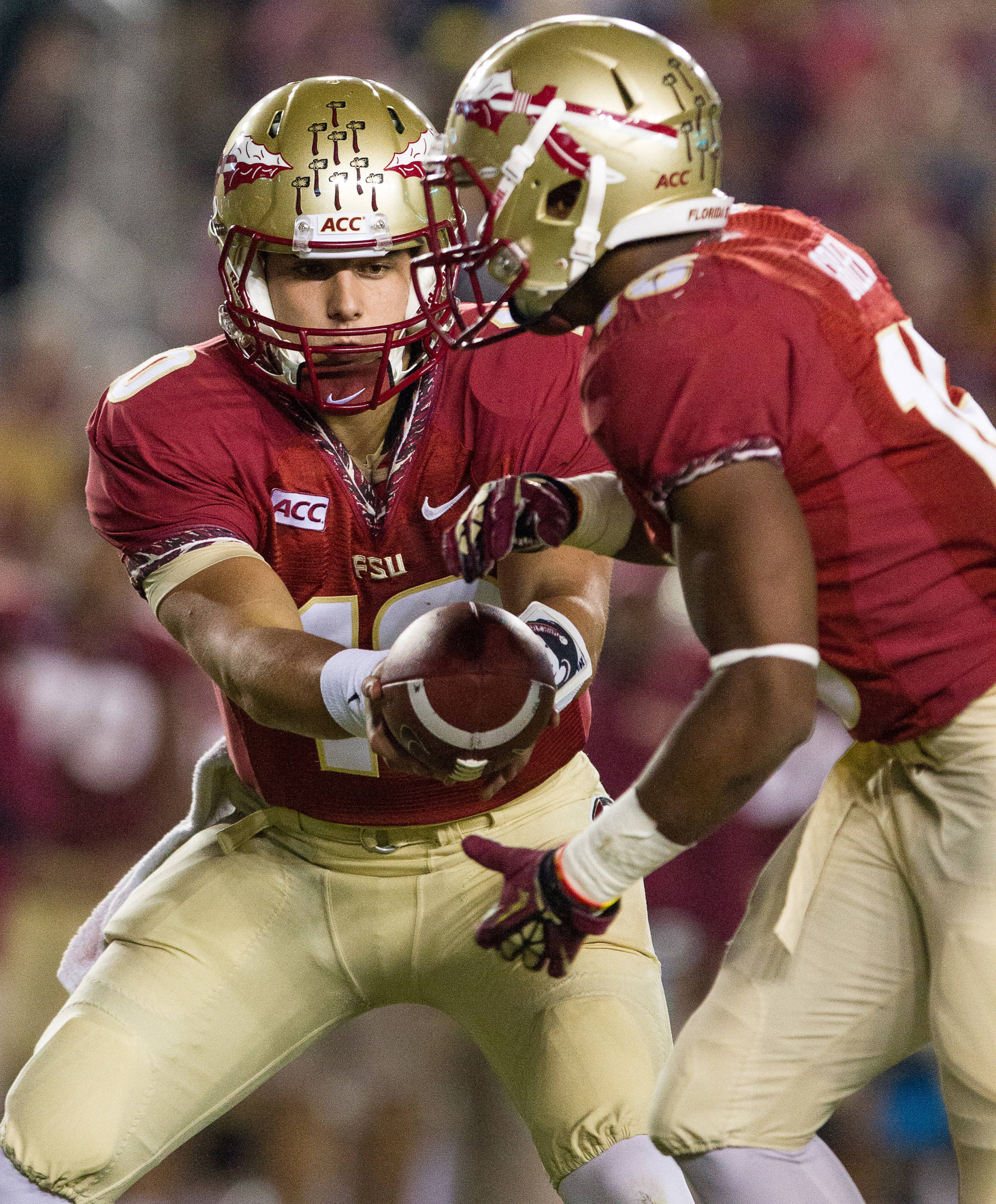 Sean Maguire (10) makes a handoff during FSU Football's 80-14 victory over Idaho in Tallahassee, Fla on Saturday, November 23, 2013. Photos by Mike Schwarz.