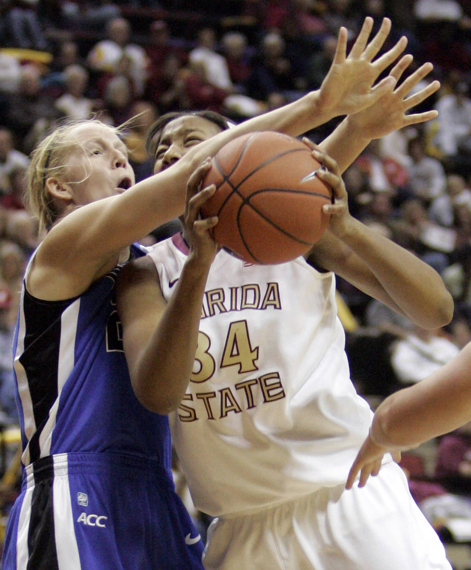 Florida State's Chelsea Davis, right, tries to shoot past the defense of Duke's KIathleen Scheer, left, in the first half of an NCAA college basketball game on Friday, Jan. 14, 2011, in Tallahassee, Fla. (AP Photo/Steve Cannon)