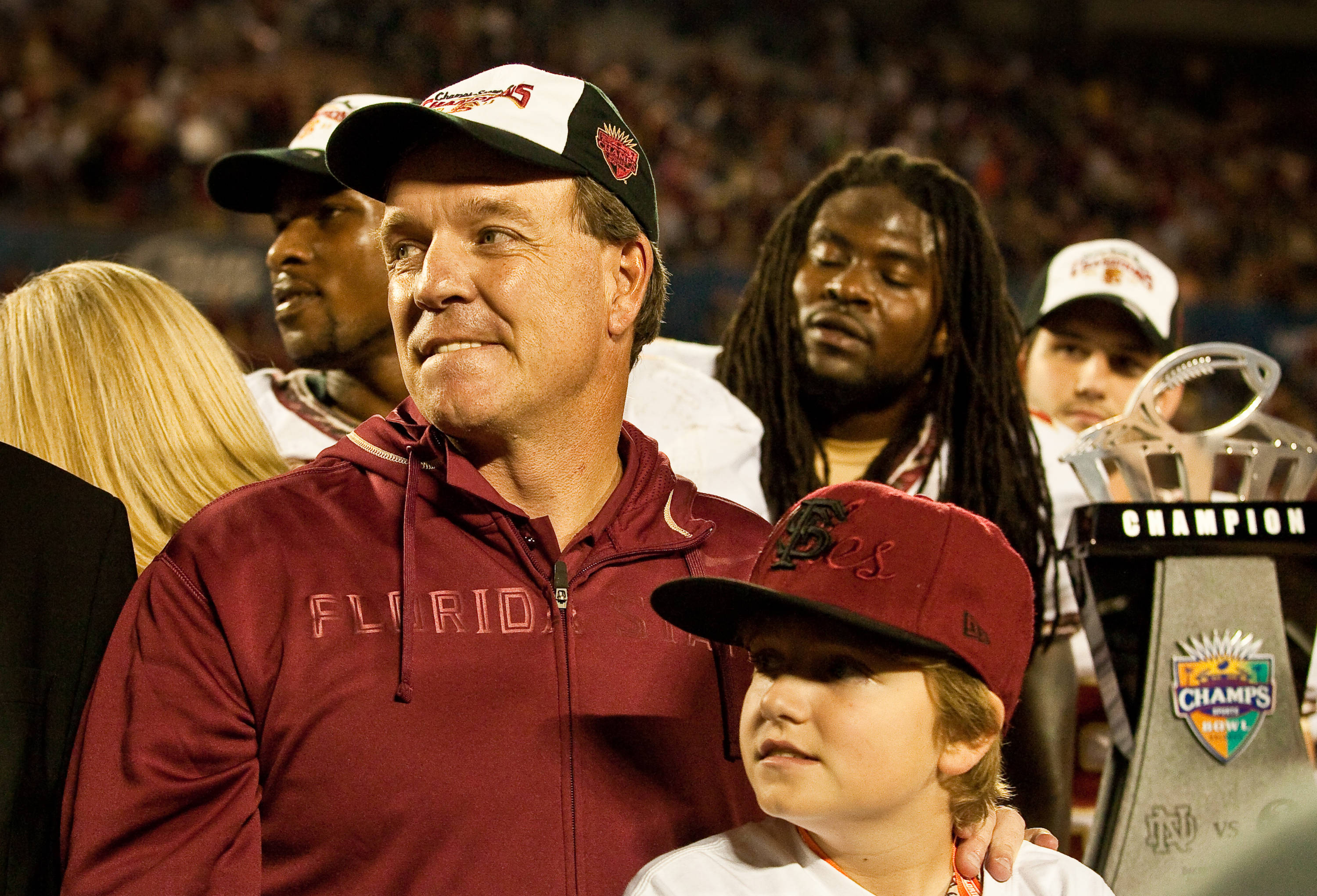 Jimbo Fisher celebrates the Champs Sports victory with his son Trey.