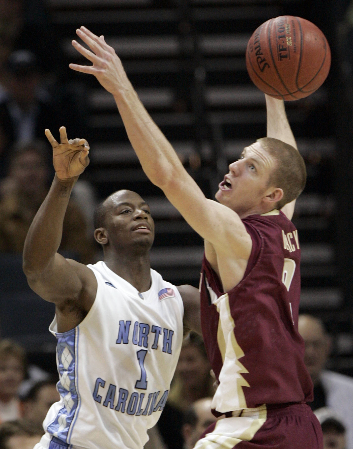 North Carolina's Marcus Ginyard and Jordan Demercy battle for a rebound in the first half. (AP Photo/Steve Helber)