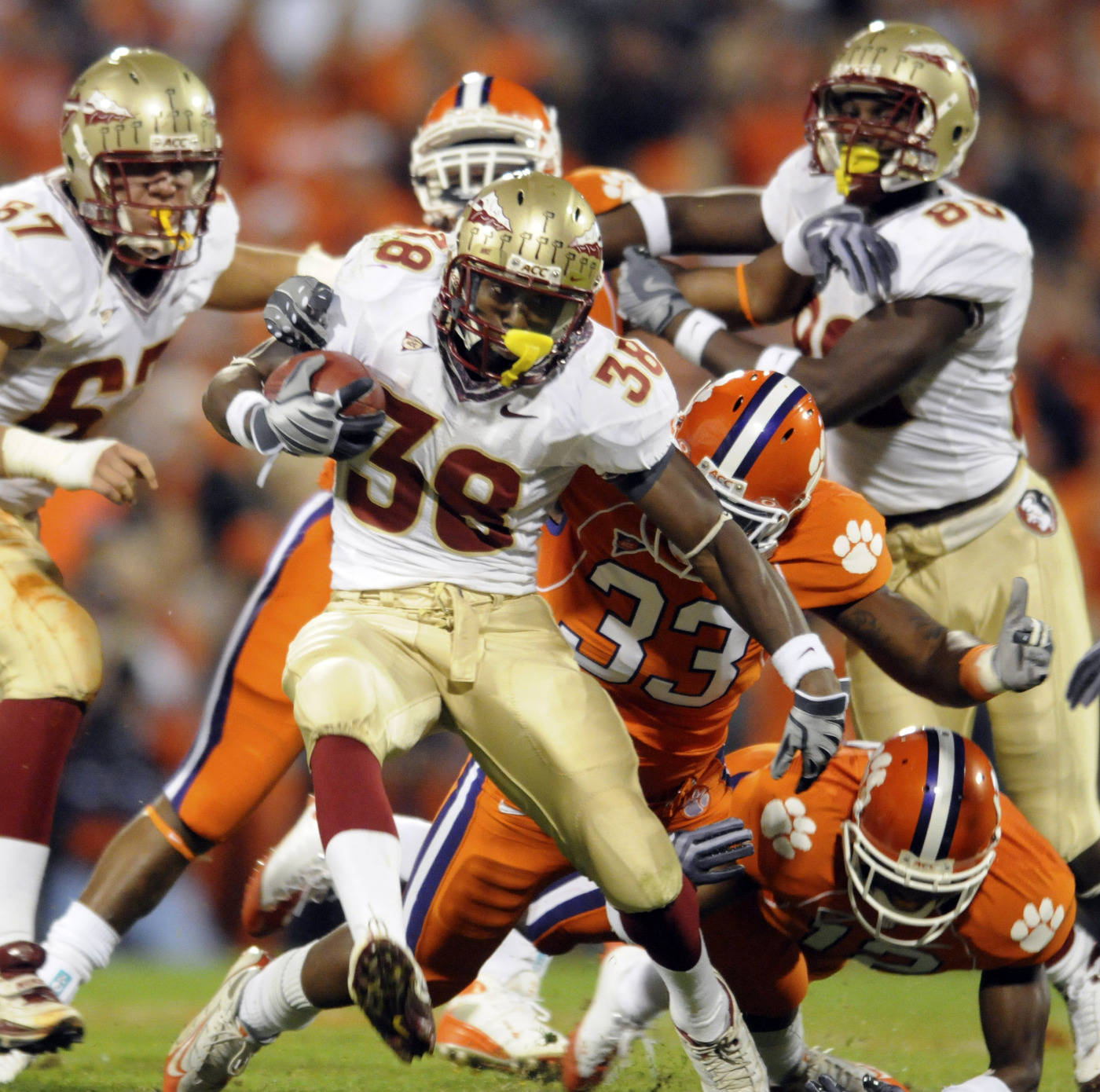 Florida State's Jermaine Thomas (38) breaks for a first down past Clemson's Kavell Conner (33) during the first half. (AP Photo/Richard Shiro)