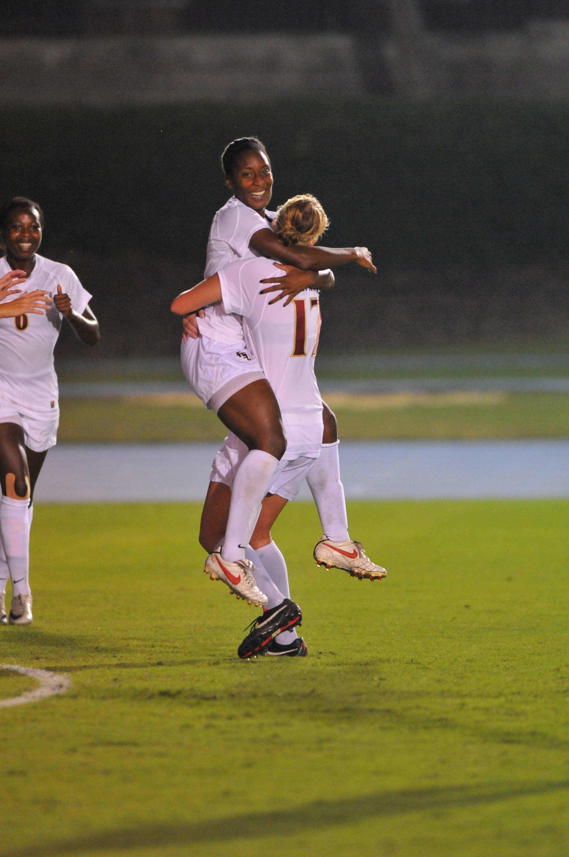 Tiffany McCarty celebrates with Ella Stephan after scoring a goal against Florida.