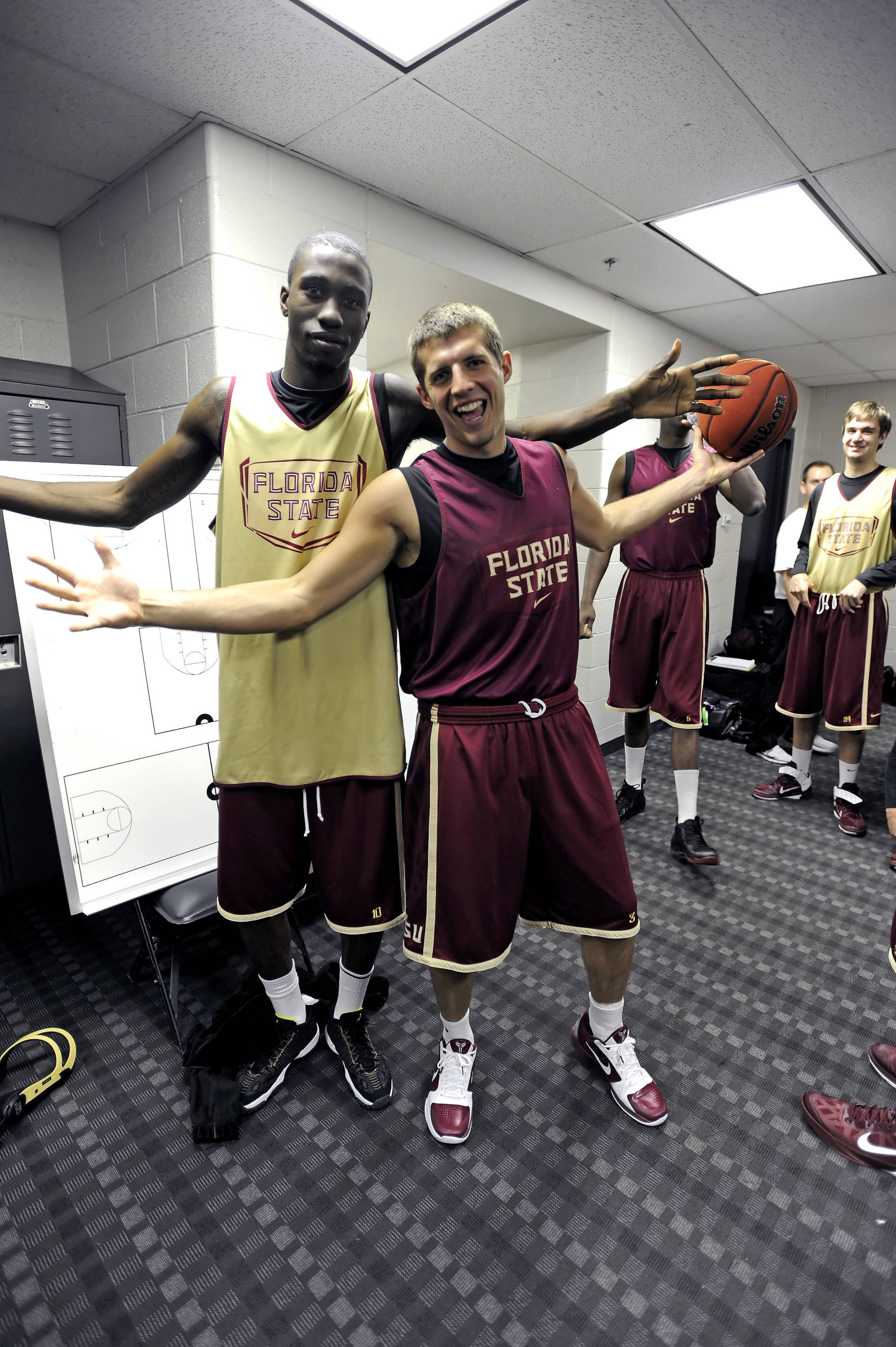 Okaro White and Luke Loucks show their lighter side in the locker room
