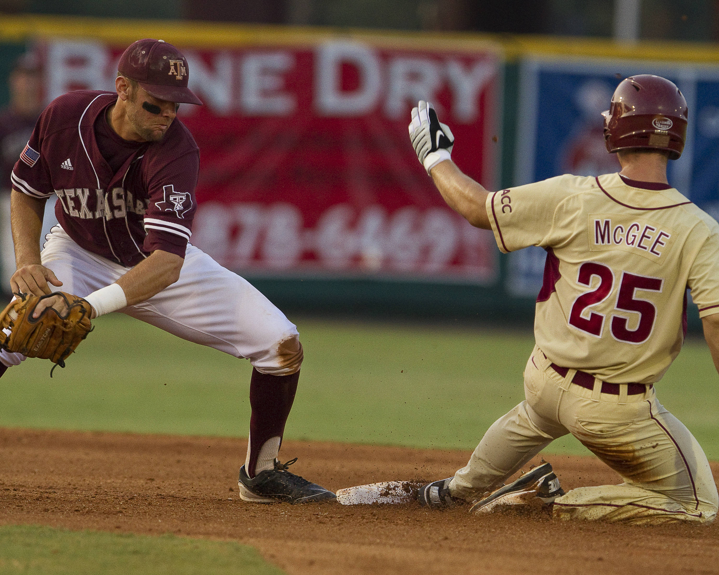 Mike McGee (25) slides into second.