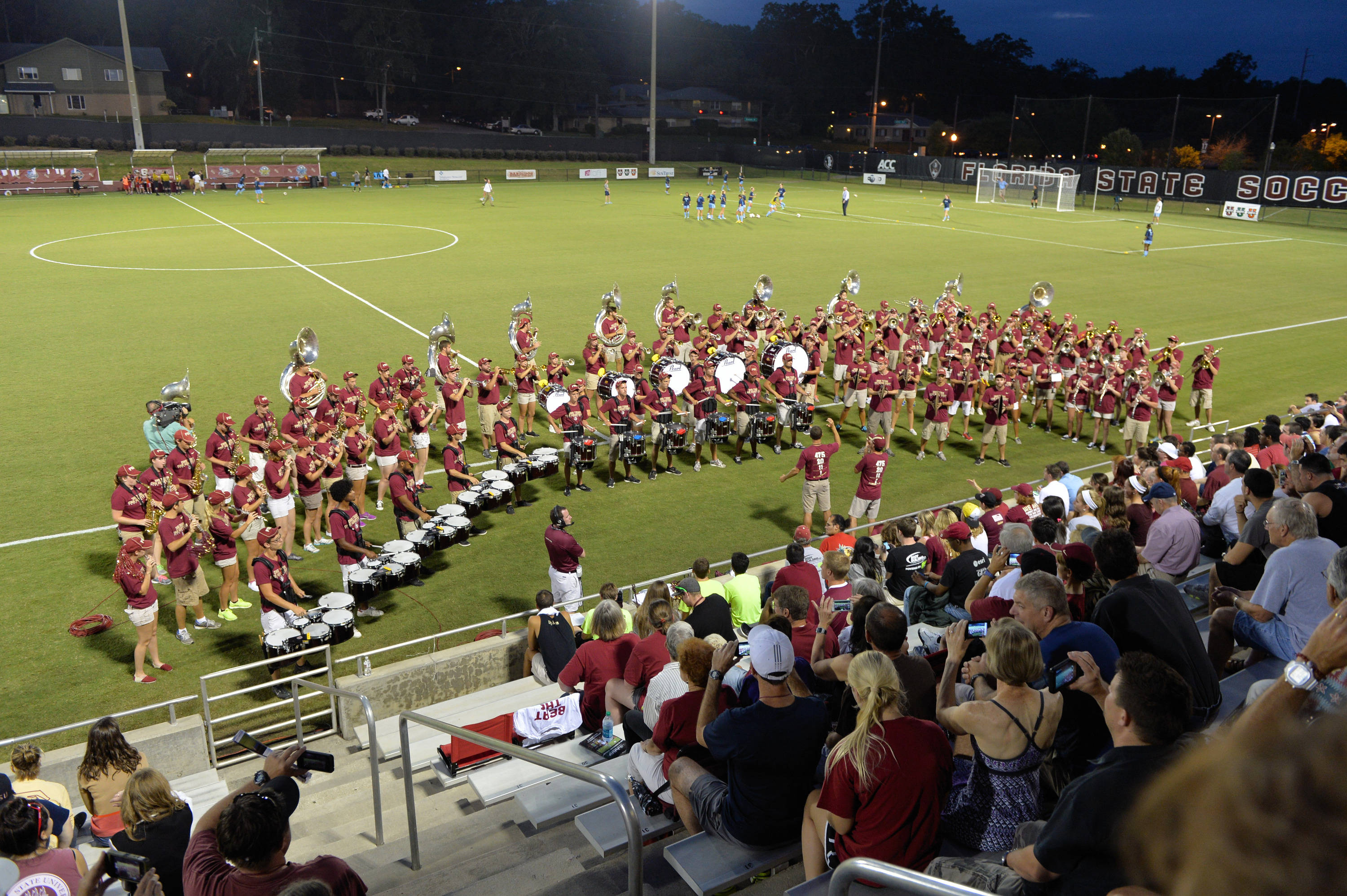 The Marching Chiefs play during pre-game at the Soccer Complex Wednesday night.