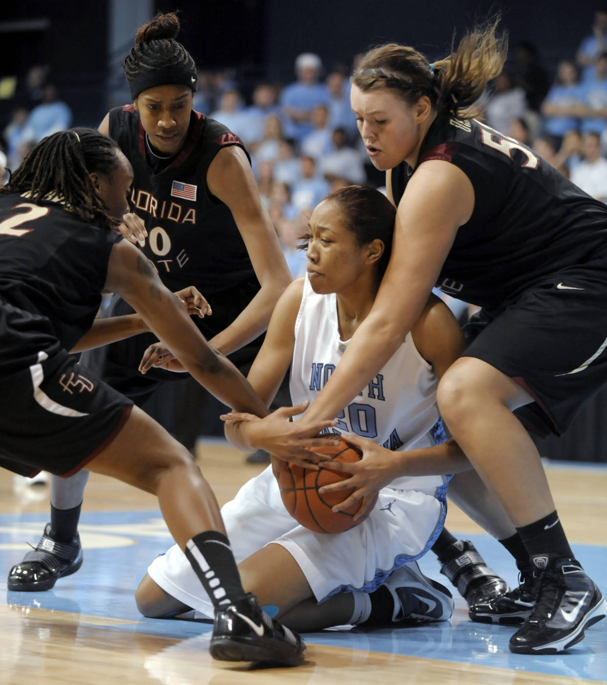 North Carolina's Chay Shegog, center, battles to keep the ball from Florida State's Alysha Harvin (2), Jacinta Monroe, left rear, and Cierra Bravard, right, during the first half an NCAA college basketball game in Durham, N.C., Monday, Feb. 1, 2010. (AP Photo/Sara D. Davis)