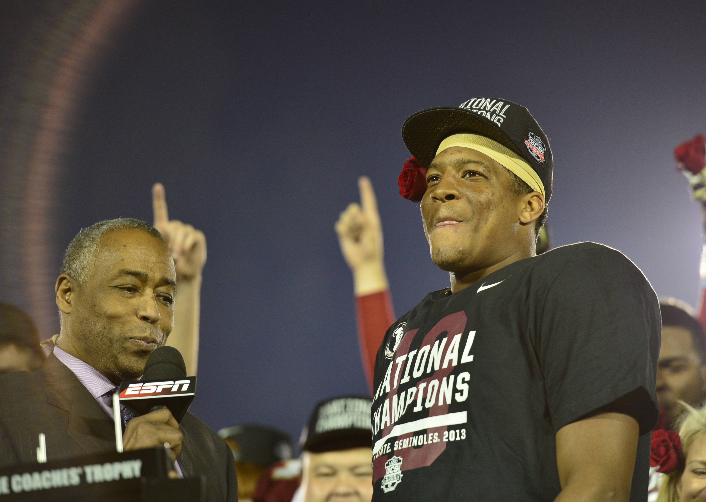 Jan 6, 2014; Pasadena, CA, USA; Florida State Seminoles quarterback Jameis Winston (5) is interviewed after winning the 2014 BCS National Championship game against Auburn Tigers 34-31 at the Rose Bowl.  Mandatory Credit: Richard Mackson-USA TODAY Sports