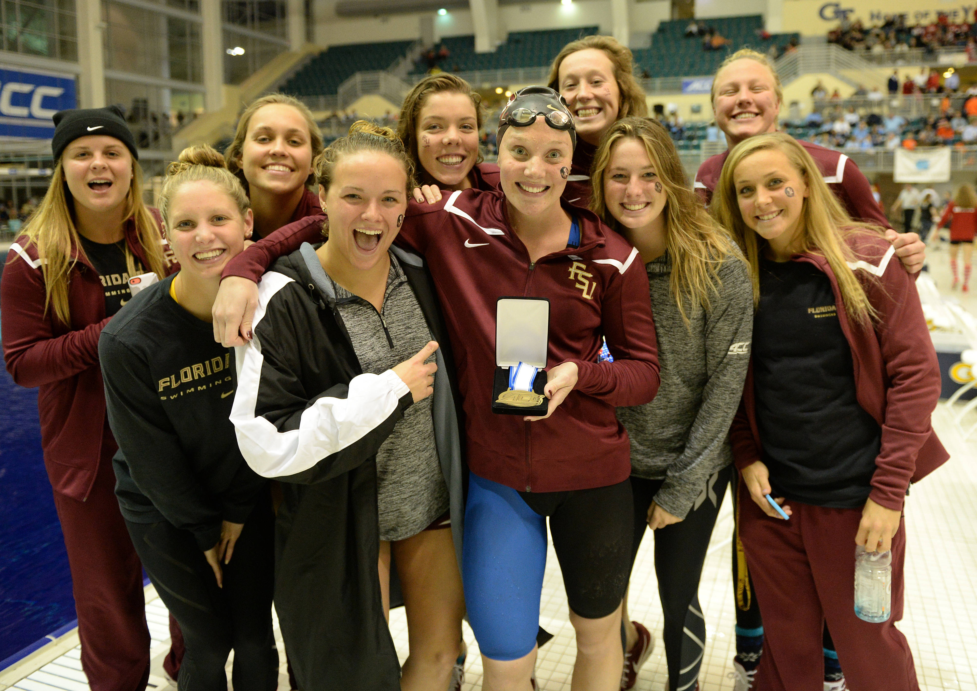Kaitlyn Dressel smiles with her team after the 50 free - Mitch White