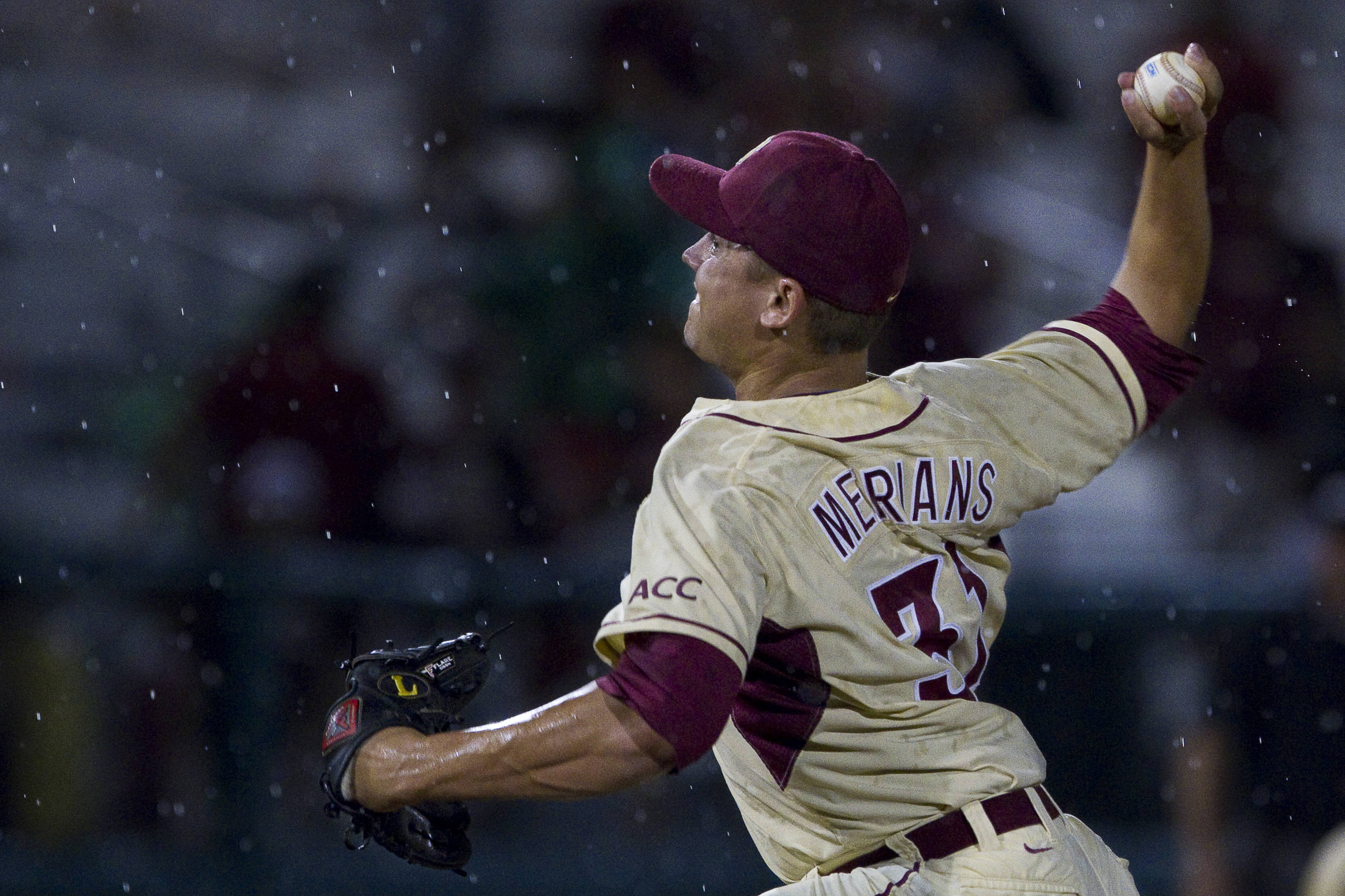 Gary Merians (31) pitches in the rain in the 8th inning.
