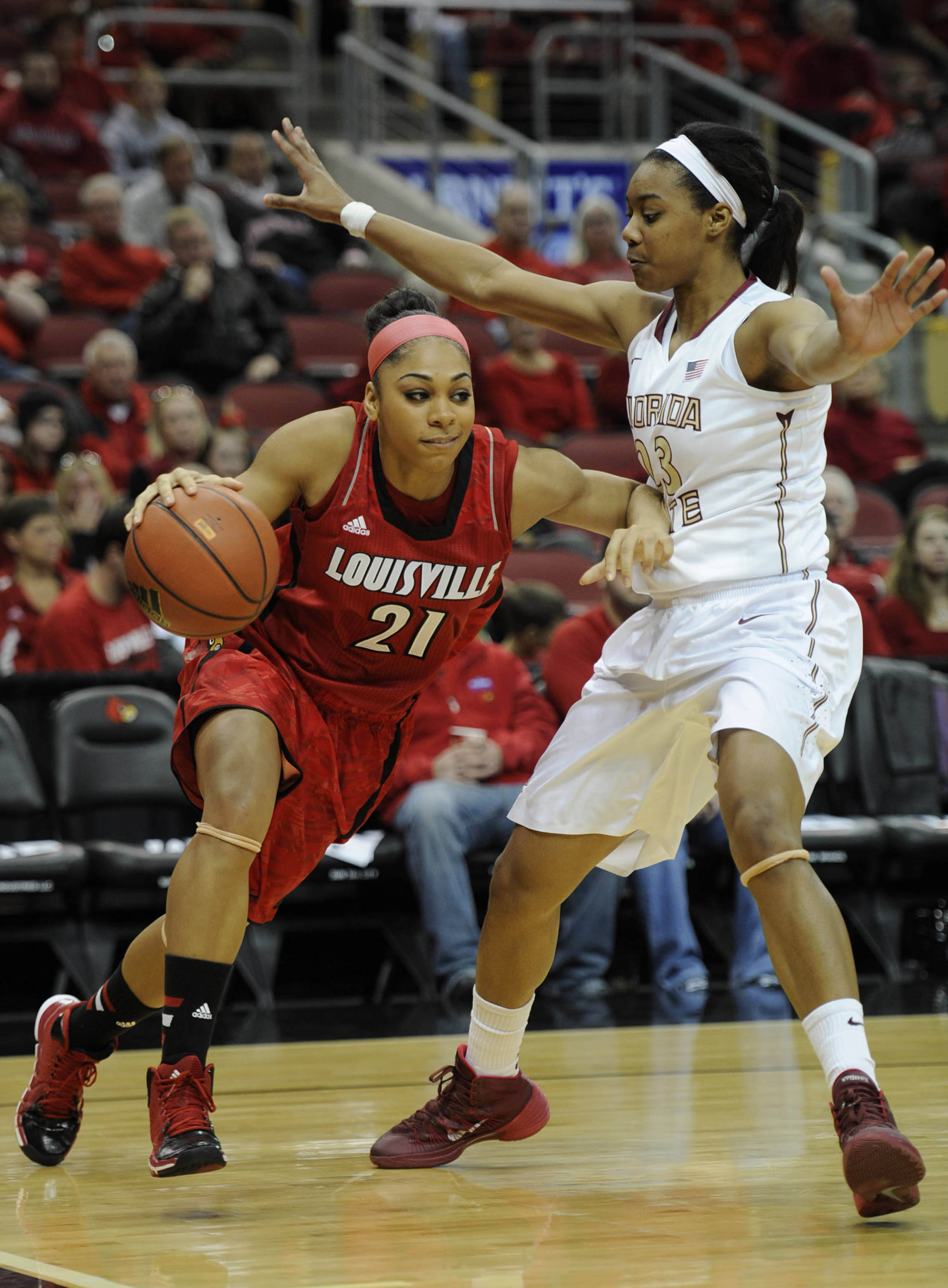 Nov 24, 2013; Louisville, KY, USA; Louisville Cardinals guard Bria Smith (21) dribbles against Florida State Seminoles forward Ivey Slaughter (23) during the first half at KFC YUM! Center. Mandatory Credit: Jamie Rhodes-USA TODAY Sports