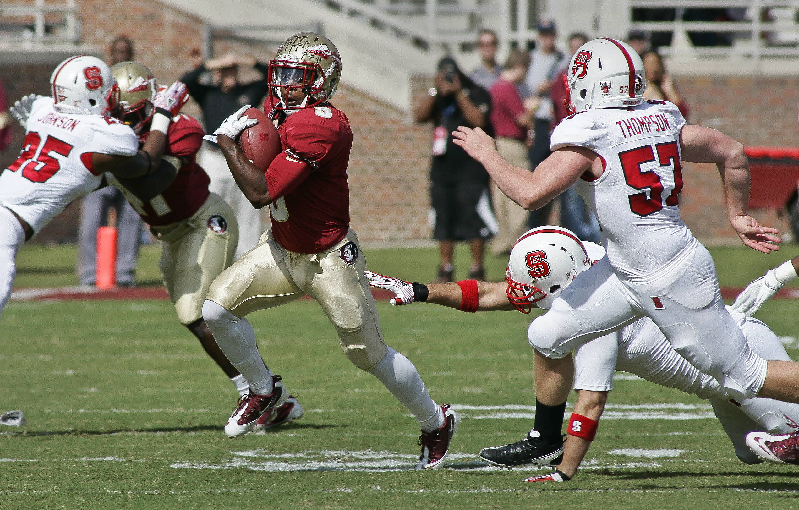Florida State punt returner Greg Reid (5) carries the ball for a 28-yard return in the first quarter against North Carolina State. (AP Photo/Phil Sears)