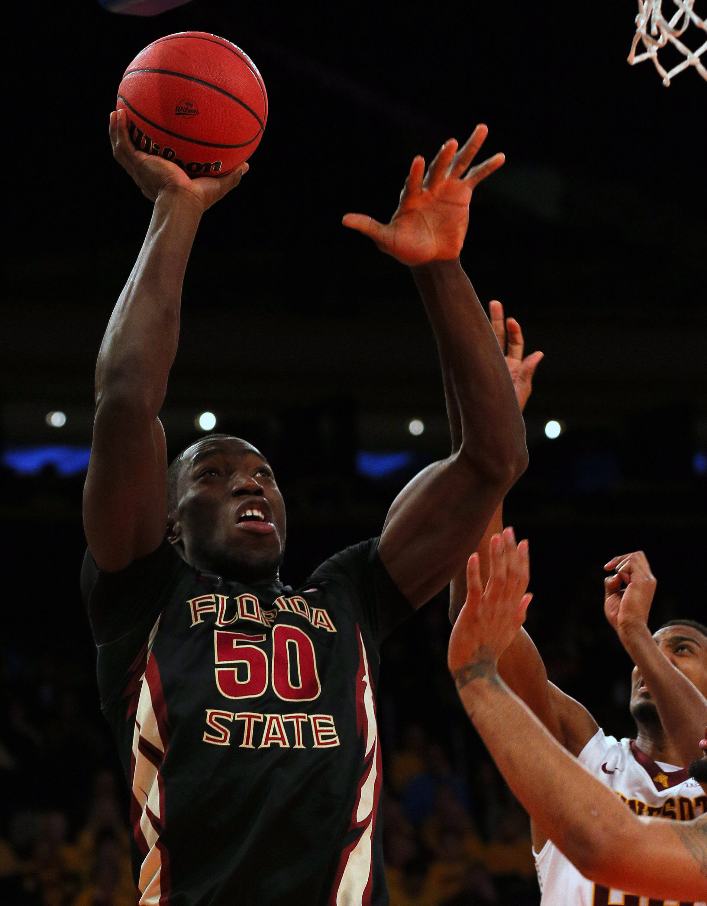 Apr 1, 2014; New York, NY, USA; Florida State Seminoles center Michael Ojo (50) shoots against the Minnesota Golden Gophers during the first half at Madison Square Garden. Mandatory Credit: Adam Hunger-USA TODAY Sports