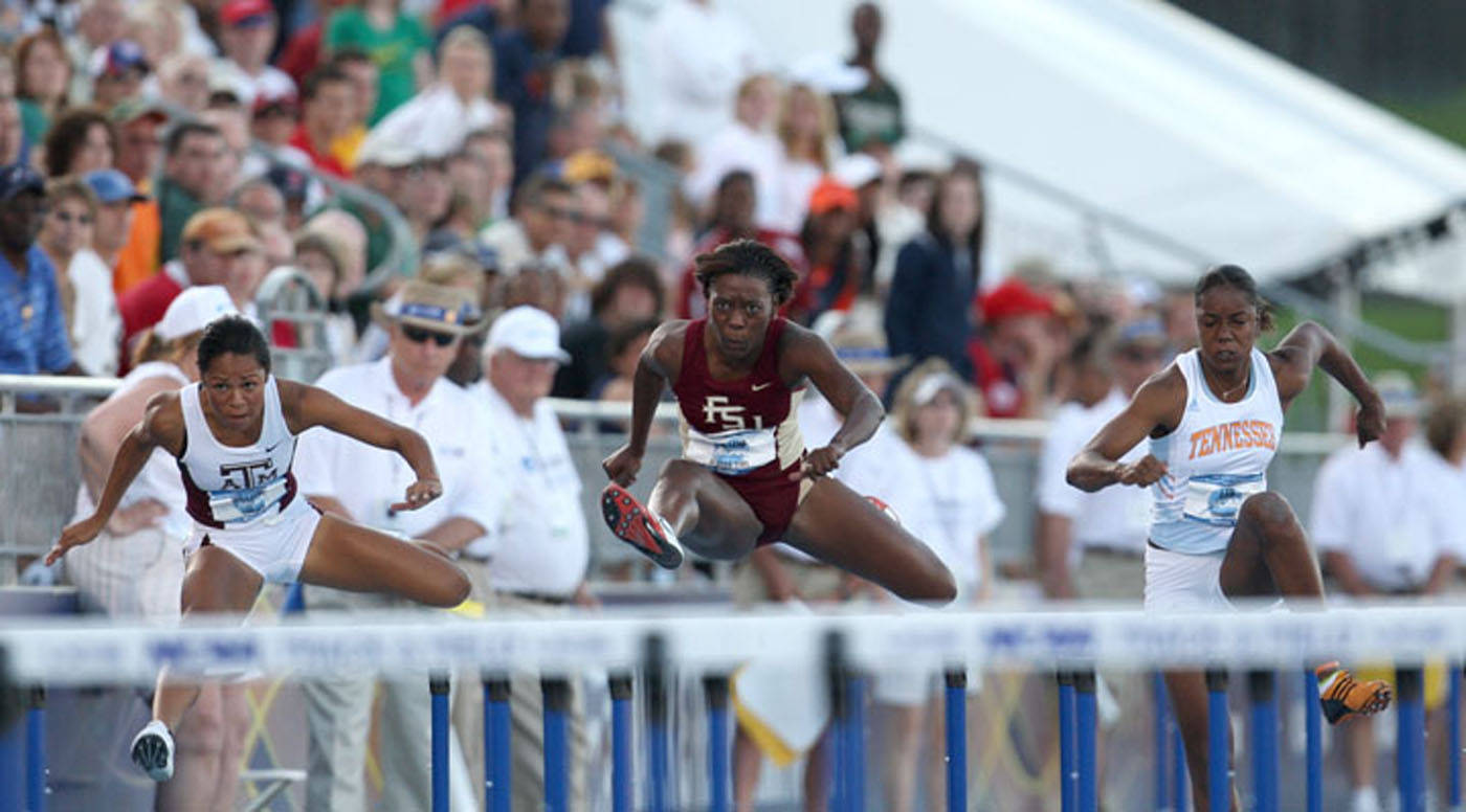 Teona Rodgers going over the hurdles in the 100m race.