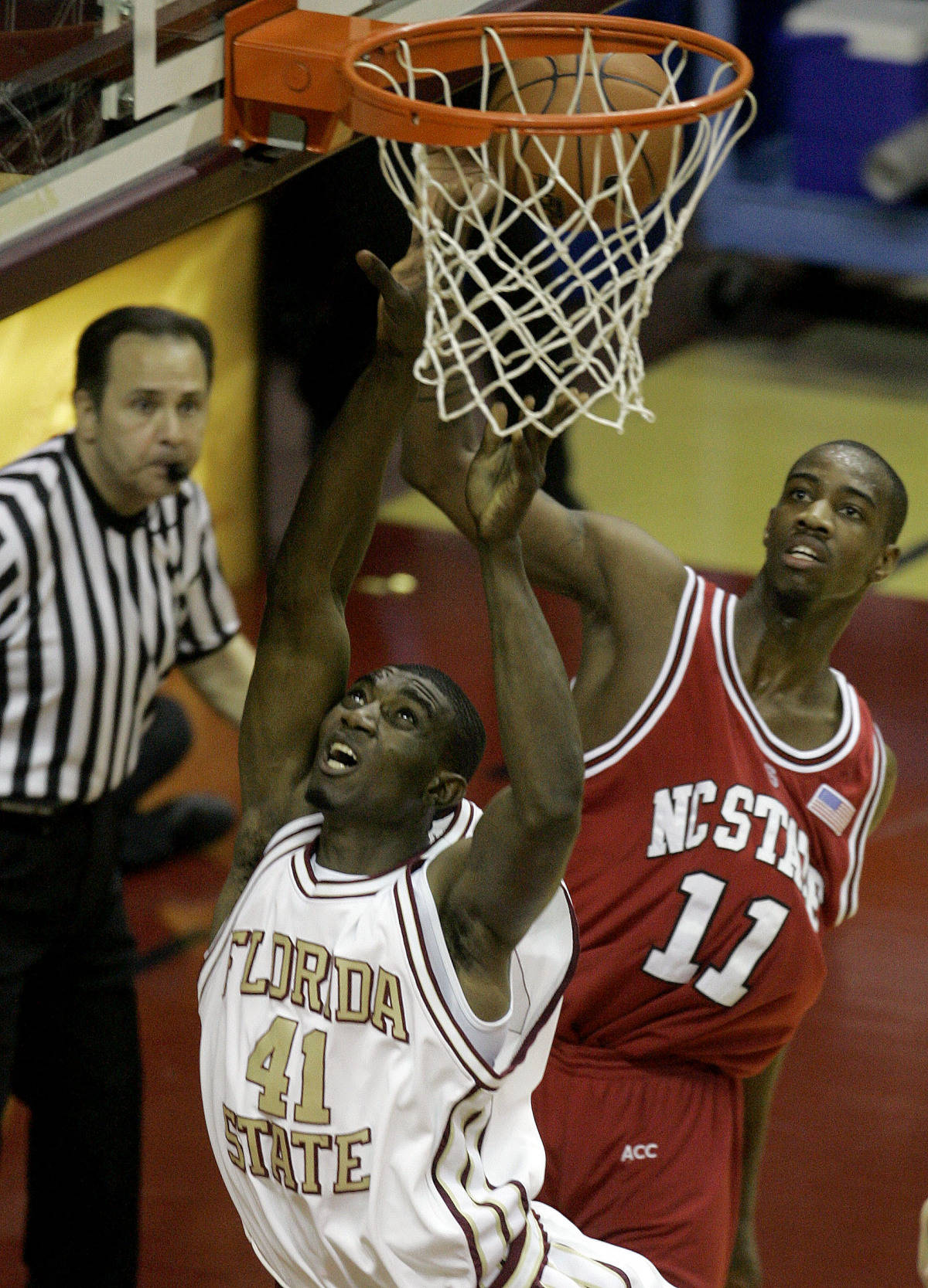 Florida State's Uche Echefu (41) is fouled by North Carolina State's Gavin Grant (11) during the first half of a college basketball game, Saturday, Feb. 24, 2007, in Tallahassee, Fla. (AP Photo/Phil Coale)