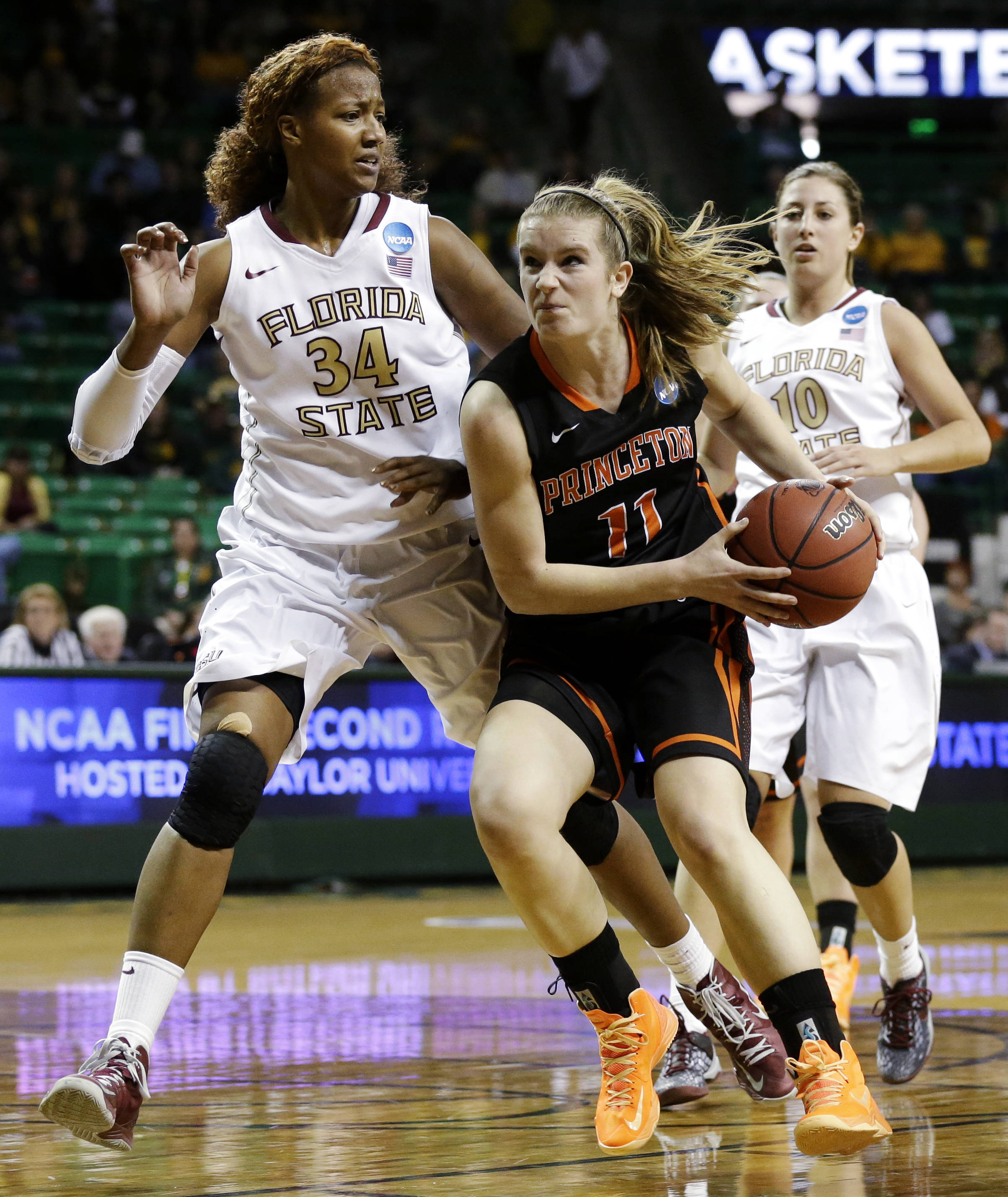 Princeton's Blake Dietrick (11) moves to the basket against Florida State's Chelsea Davis (34) as Leonor Rodriguez (10) watches in the second half of a first-round game in the women's NCAA college basketball tournament, Sunday, March 24, 2013, in Waco, Texas. FSU won 60-44. (AP Photo/Tony Gutierrez)