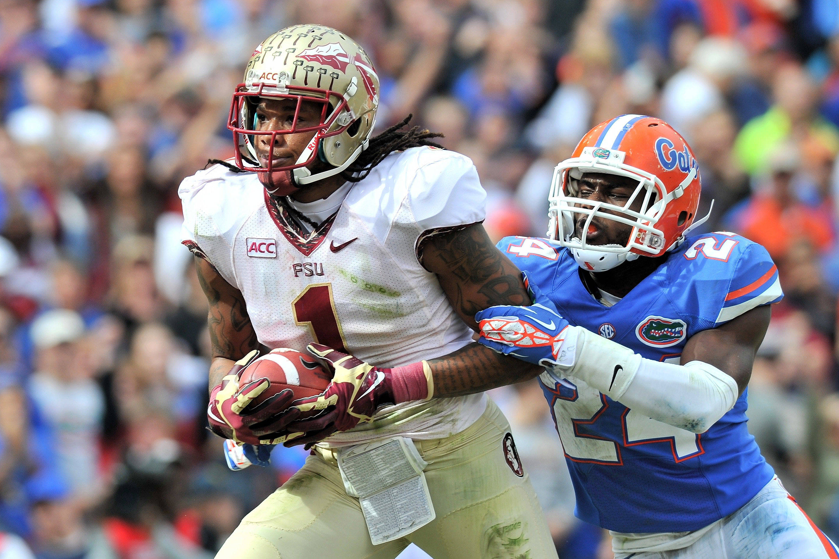 Kelvin Benjamin (1) runs in a touchdown as Florida Gators defensive back Brian Poole (24) defends. Mandatory Credit: Steve Mitchell-USA TODAY Sports
