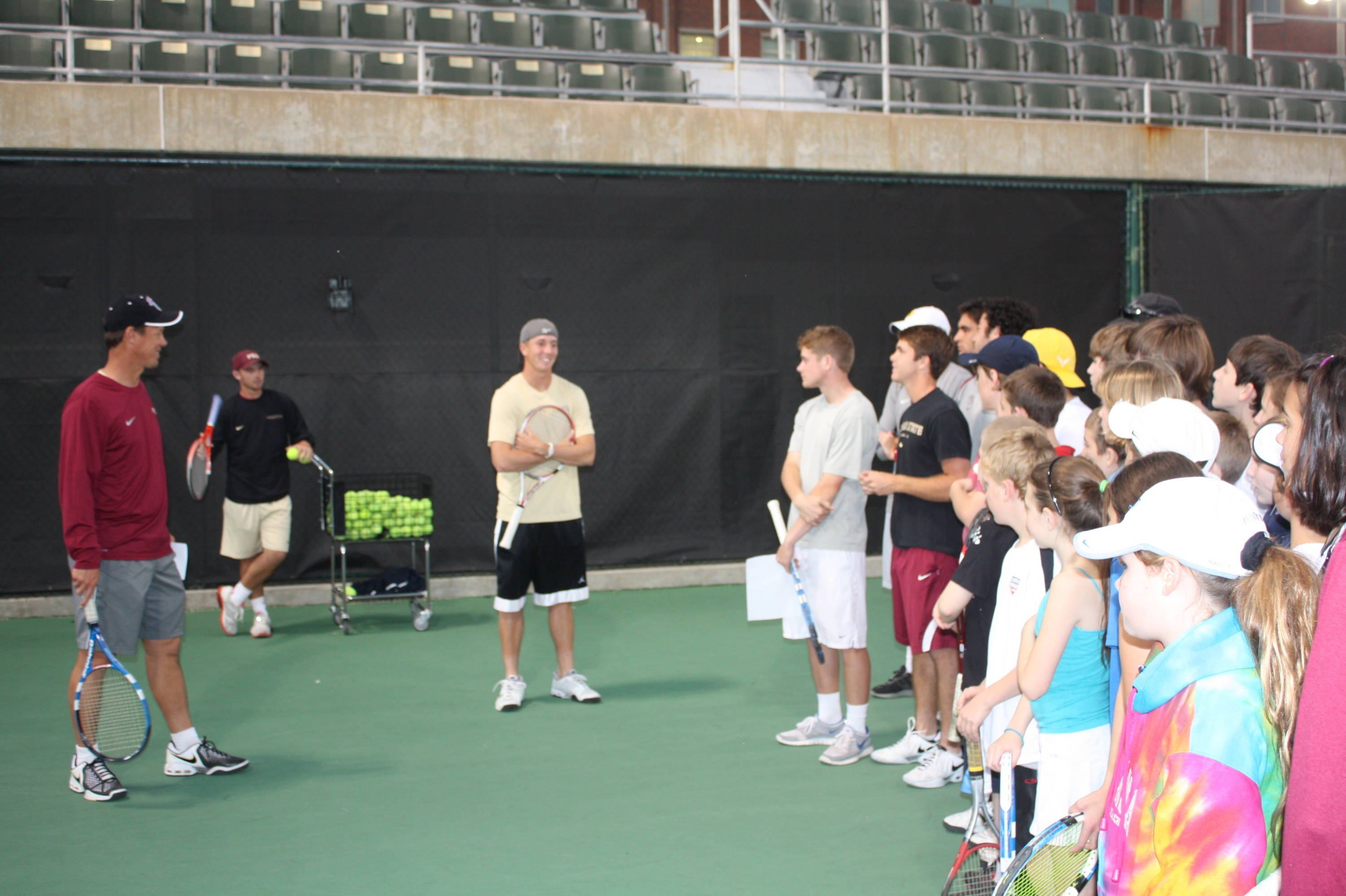 Head coach Dwayne Hultquist addresses the campers