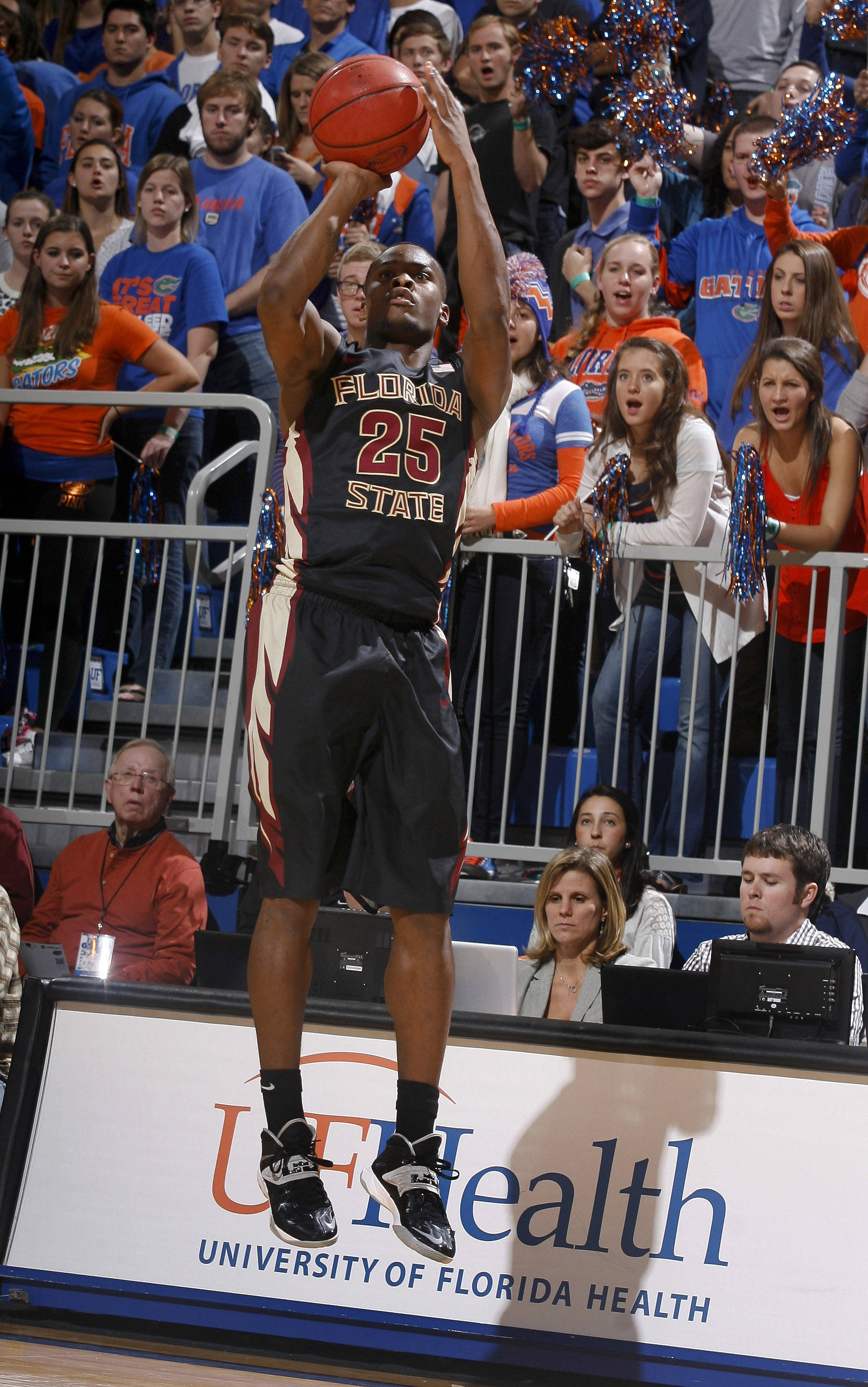 Nov 29, 2013; Gainesville, FL, USA; Seminoles guard Aaron Thomas (25) shoots a jumper in the first half. Phil Sears-USA TODAY Sports