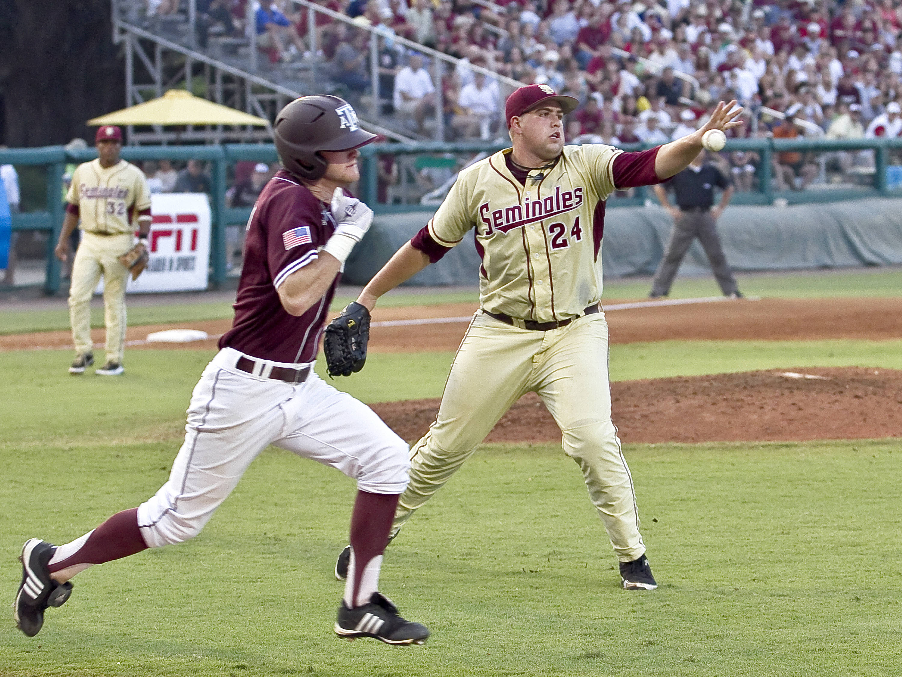 Pitcher Brian Busch (24) with an odd release of the ball for a put-out.
