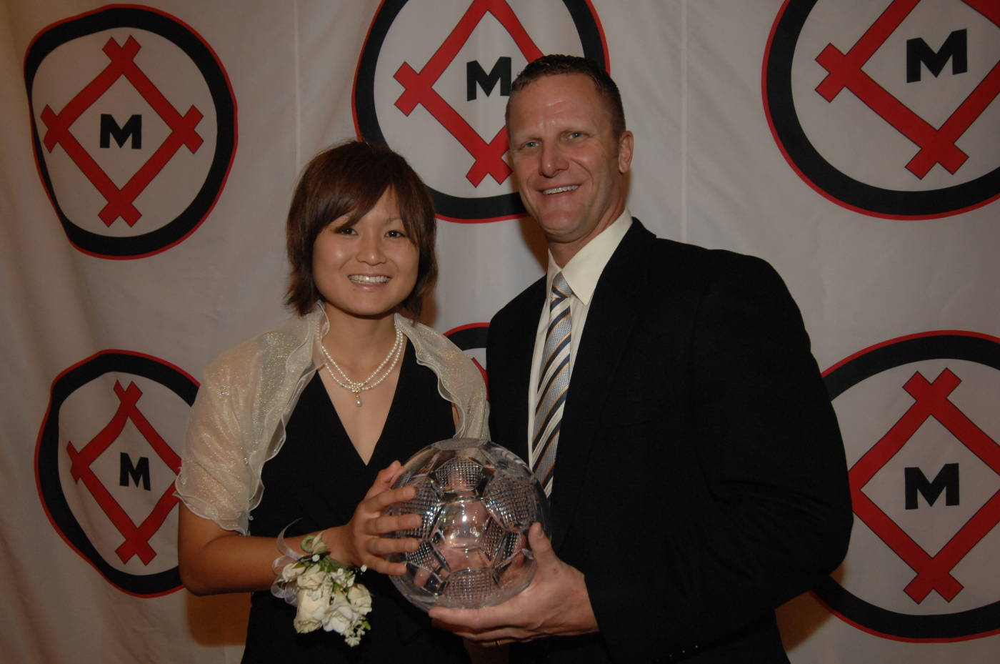 Mami Yamaguchi with the Hermann Trophy