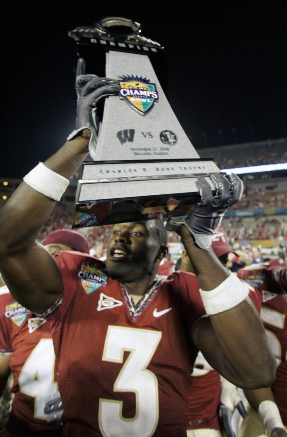 Florida State safety Myron Rolle holds up the trophy after defeating Wisconsin 42-13 in the Champs Sports Bowl. (AP Photo/John Raoux)