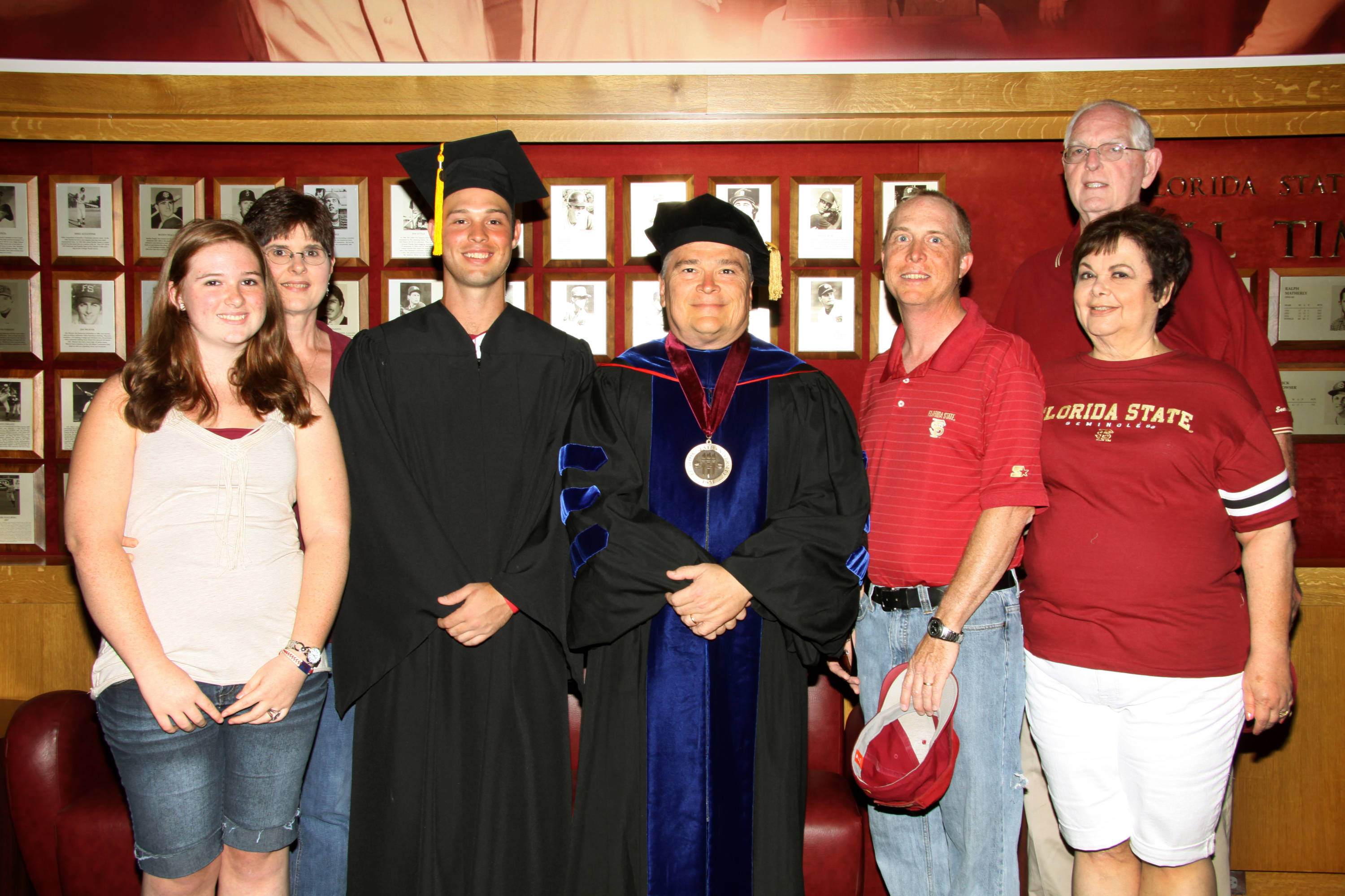 2011 Spring Graduation Ceremony held at Dick Howser Stadium to honor the graduating baseball seniors. Mike McGee (25) and family with President Barron