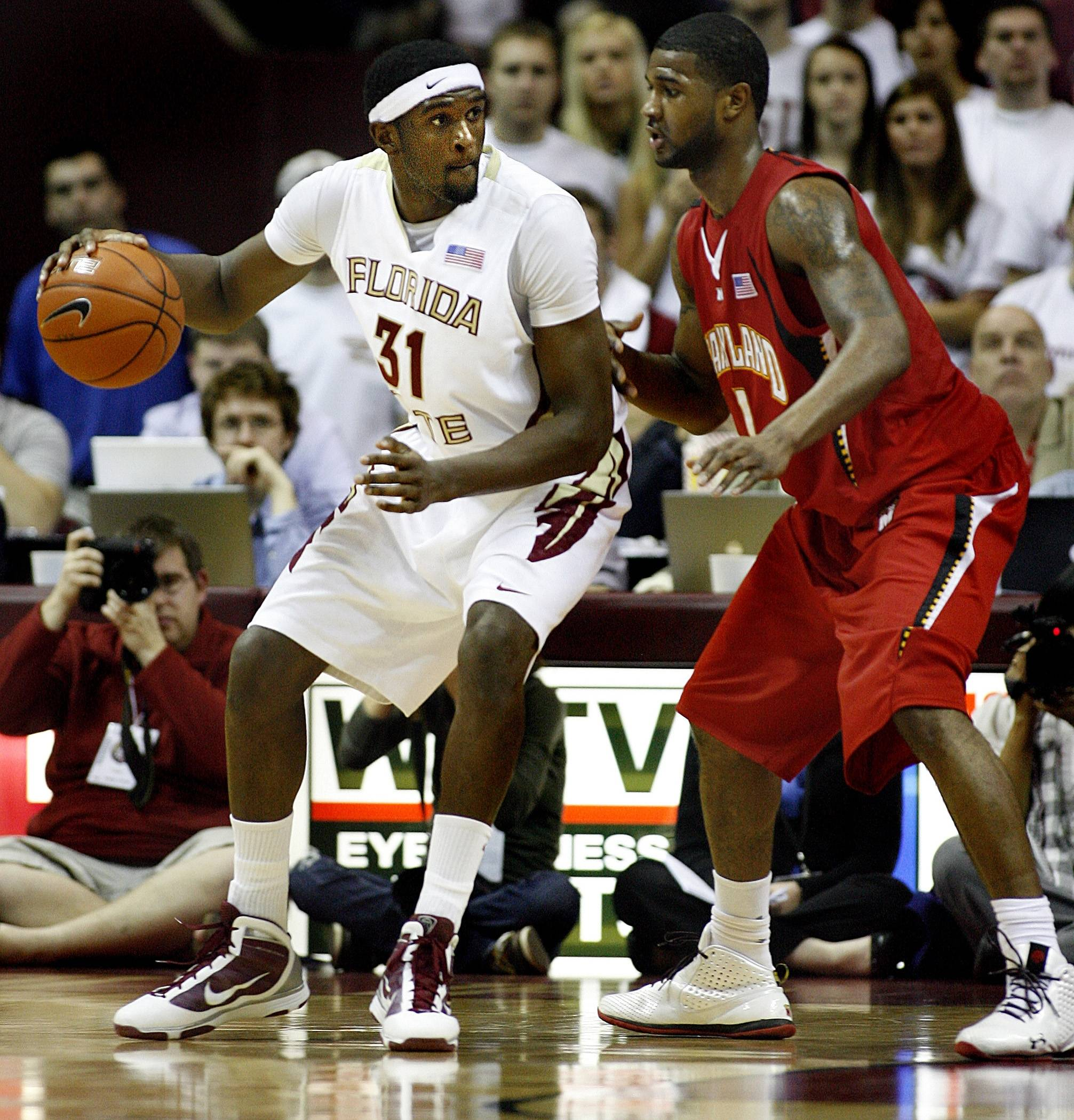 Florida State's Chris Singleton (31) moves the ball against Maryland's Landon Milbourne during an NCAA college basketball game in Tallahassee, Fla., on Thursday, Feb 4, 2010. (AP Photo/Tallahassee Democrat, Glenn Beil)