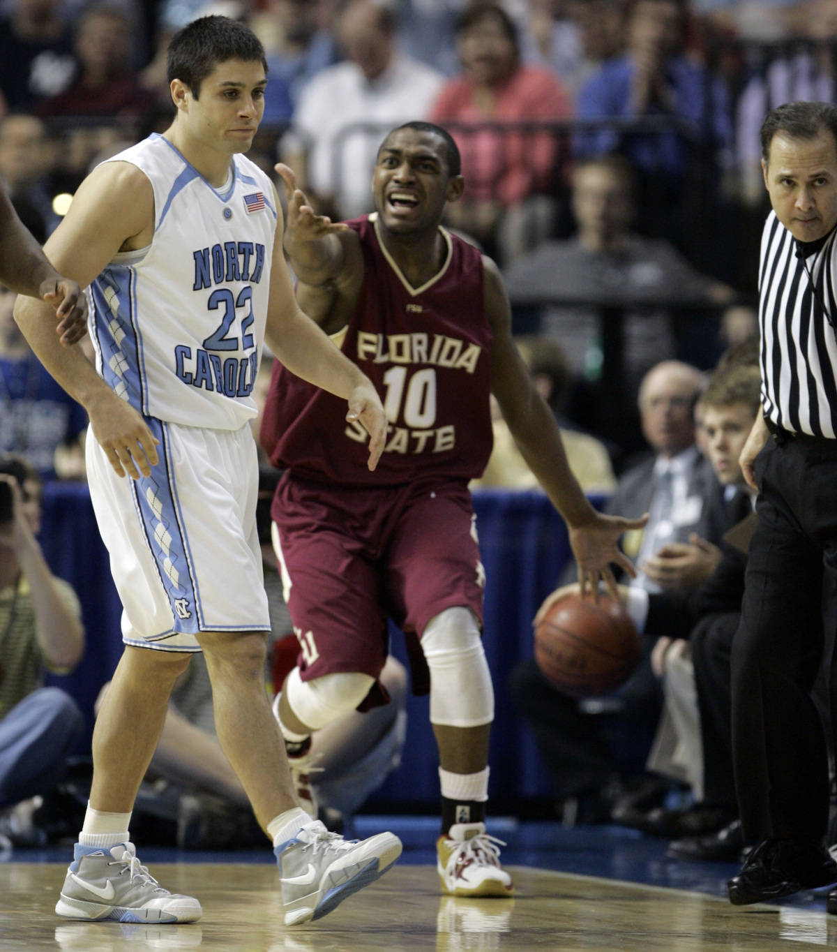 Florida State's Ralph Mims (10) gestures toward North Carolina's Surry Wood (23) during a second round game of the Men's Atlantic Coast Conference basketball tournament in Tampa, Fla., Friday, March 9, 2007. (AP Photo/David J. Phillip)