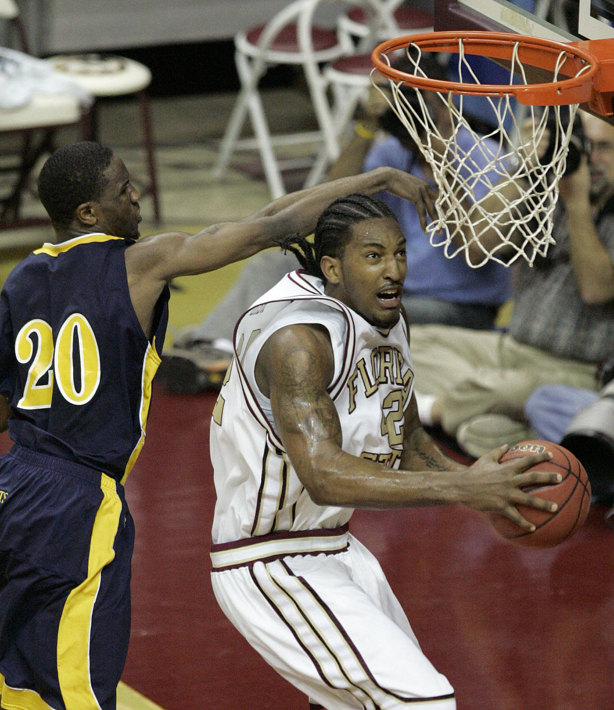 Florida State's Ryan Reid goes around Toledo's Justin Ingram (20) to score. (AP Photo/Steve Cannon)