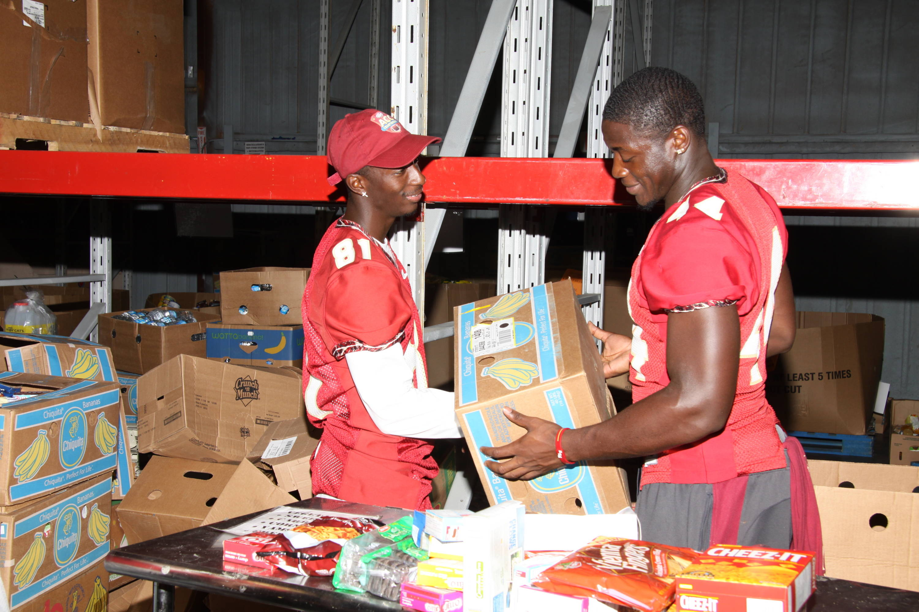 2011 FSU Football players out in the community performing community service at Second Harvest food bank.