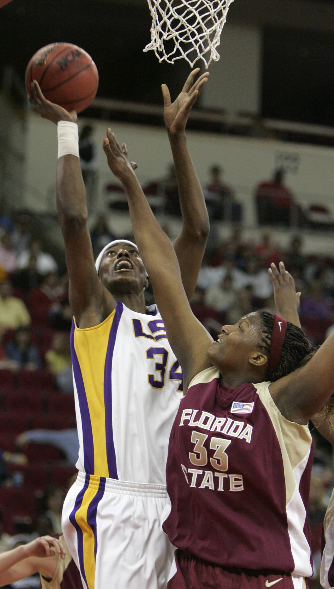 Louisiana State center Sylvia Fowles, left, shoots over Florida State center Britany Miller in the first half of an NCAA women's basketball tournament regional semifinal in Fresno, Calif., Saturday, March 24, 2007. (AP Photo/Rich Pedroncelli)