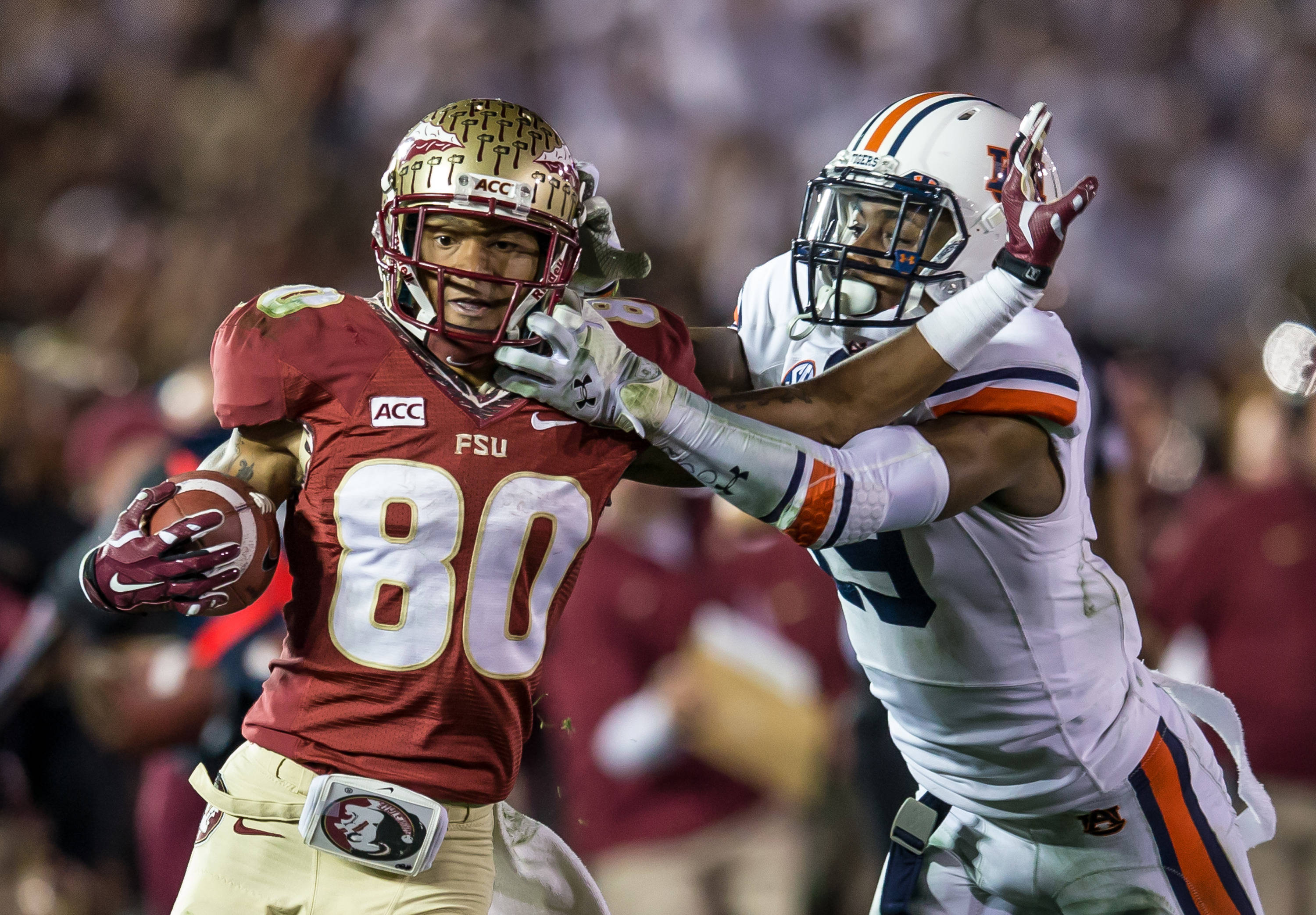 Rashad Greene (80) is brought down by his facemask during the game winning TD drive.