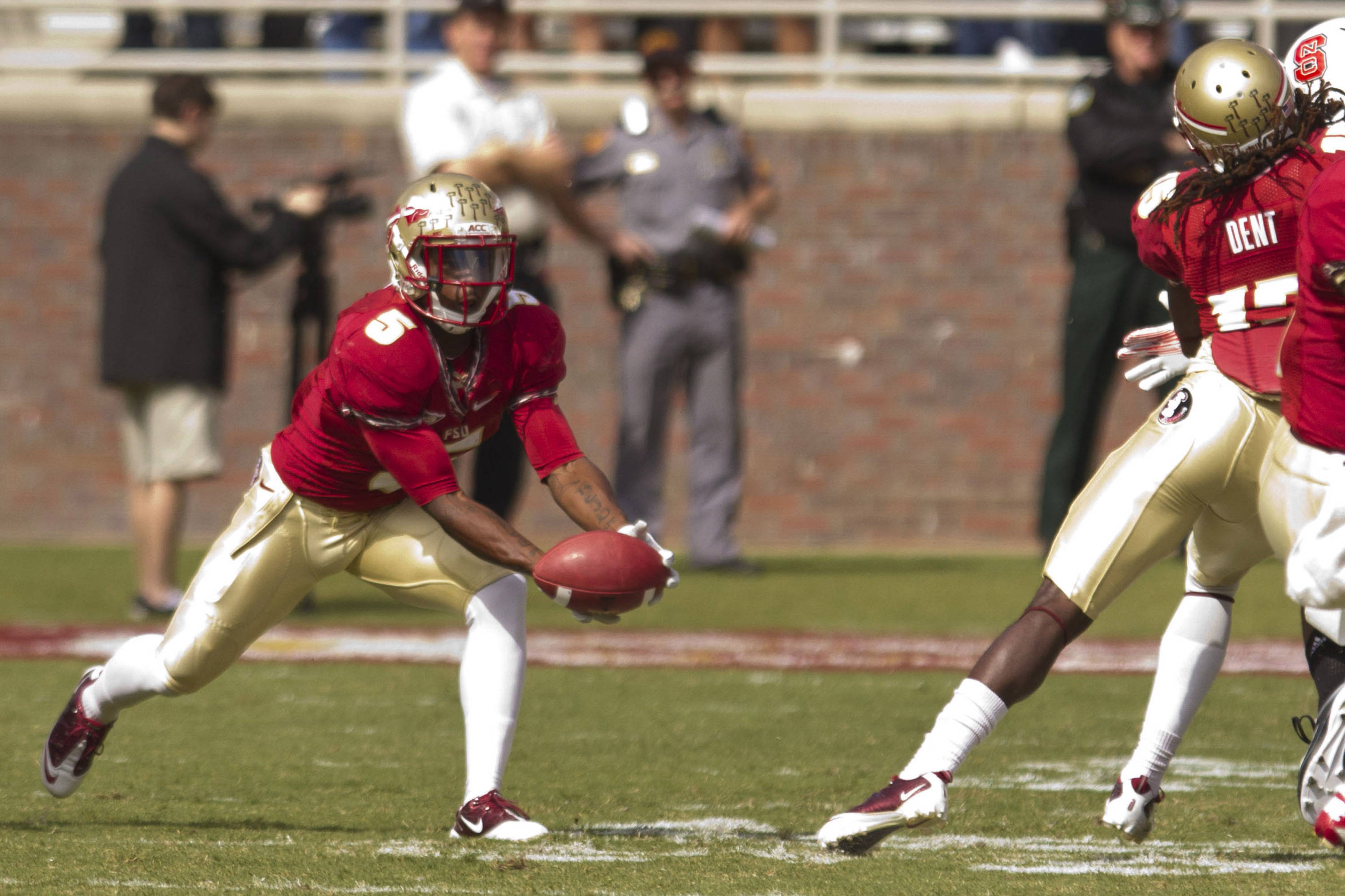 Greg Reid (5) catches a punt on the tips of his fingers during the football game against NC State on October 29, 2011.