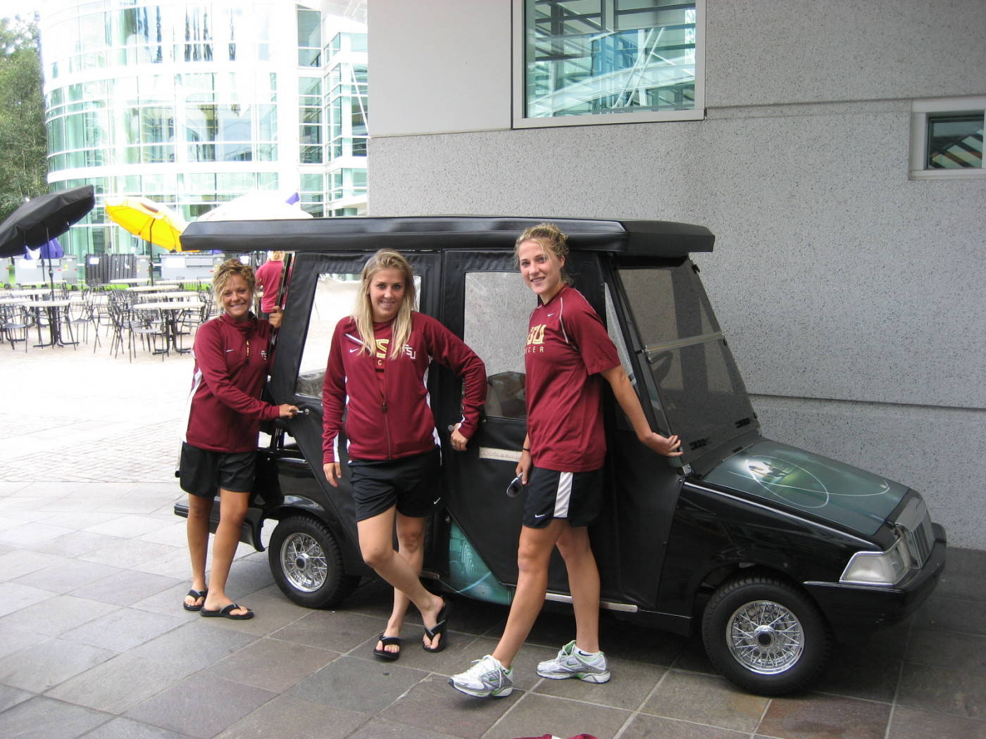 Sara, Victoria and Becky look to hitch a ride in a decked out Nike golf cart.
