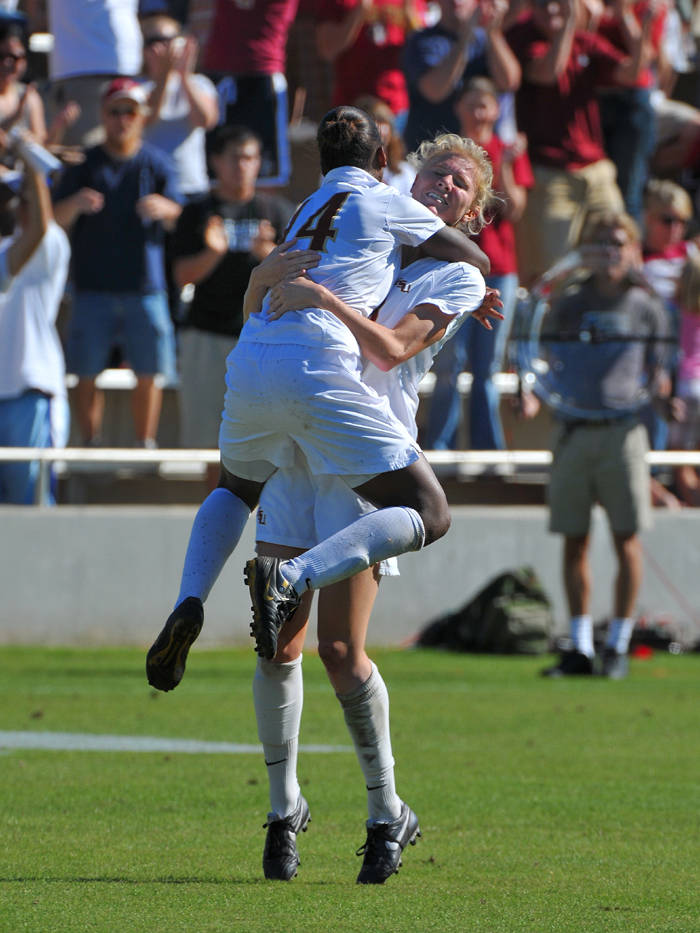 Tiffany McCarty celebrates with Lauren Switzer after scoring in the 41st minute to give FSU a 2-0 lead.