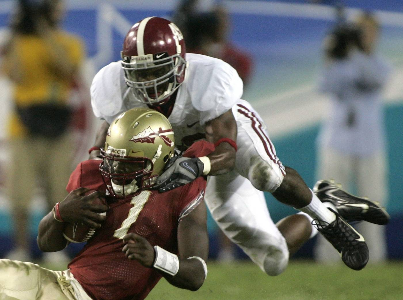 Florida State quarterback Xavier Lee, left, is tackled by Alabama's Rashad Johnson during the fourth quarter of a football game Saturday, Sept. 29, 2007, in Jacksonville, Fla. FSU won 21-14. (AP Photo/Phil Coale)