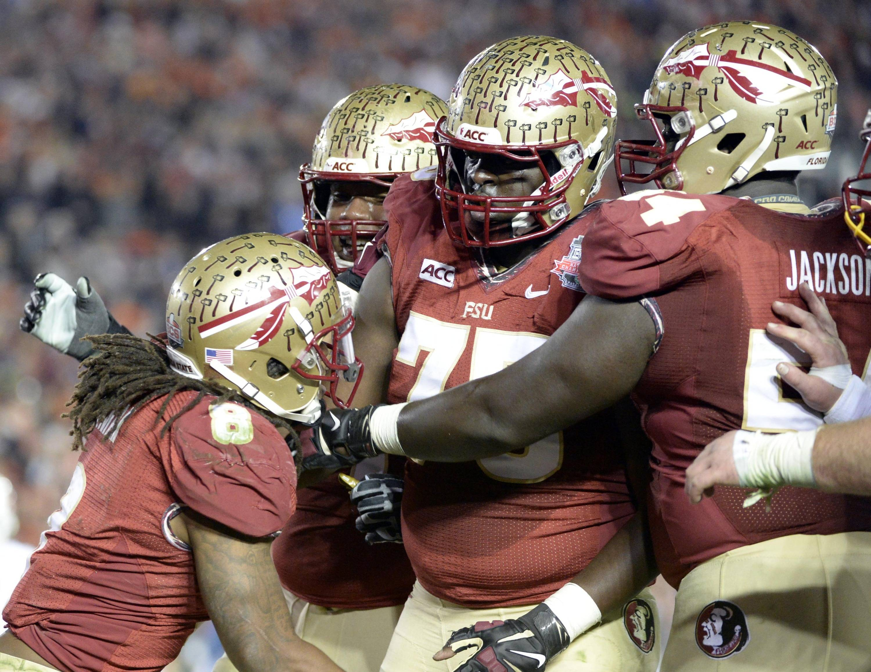 Jan 6, 2014; Pasadena, CA, USA; Florida State Seminoles running back Devonta Freeman (8) and offensive linesman Cameron Erving (75) celebrate the touchdown against the Auburn Tigers during the first half of the 2014 BCS National Championship game at the Rose Bowl.  Mandatory Credit: Richard Mackson-USA TODAY Sports